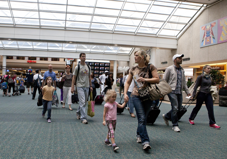 Travelers arriving at Orlando International Airport