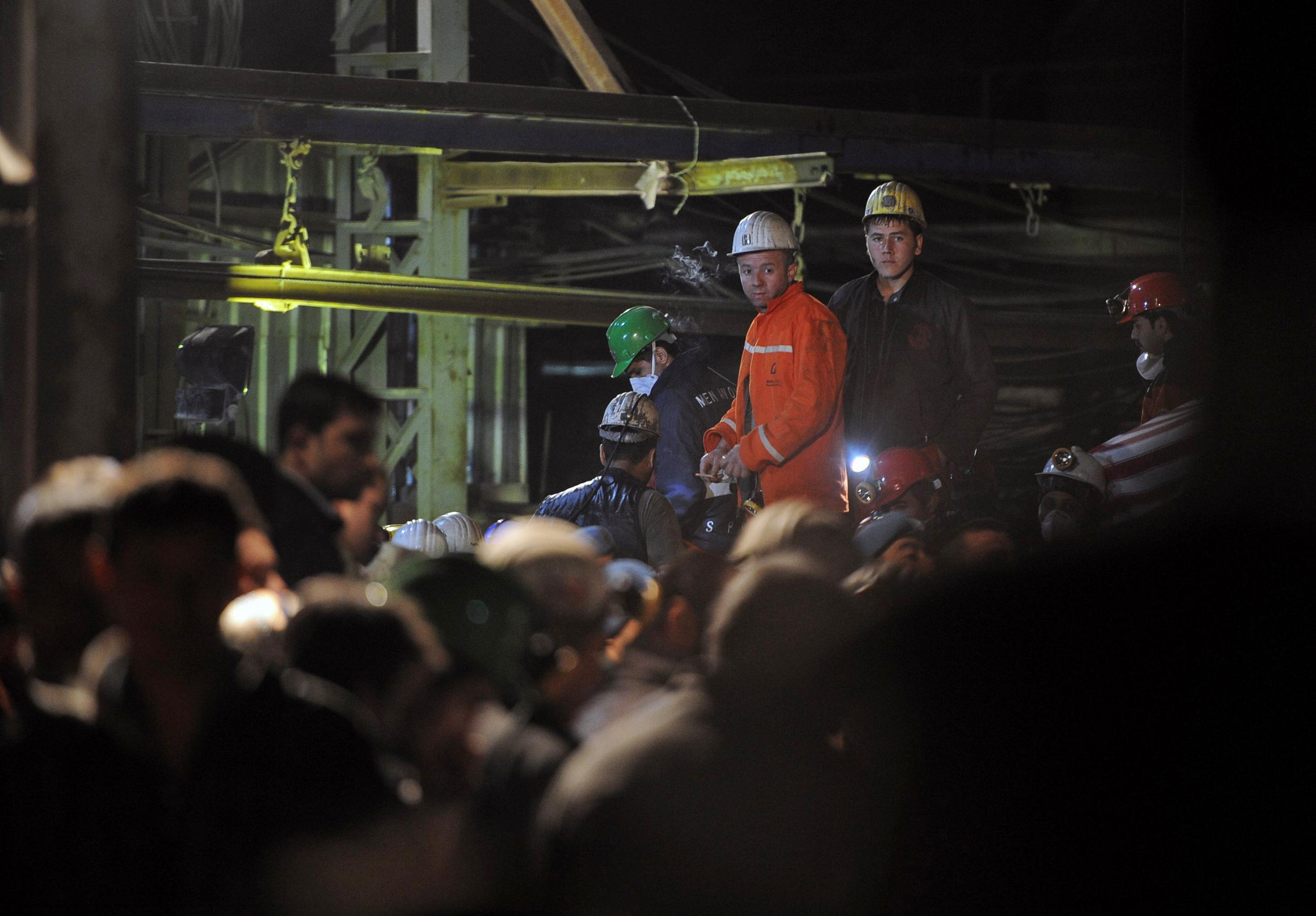 Image: Turkish rescue workers and miners at the entrance of the coal mine in Soma, Turkey, early Saturday, May 17, 2014.