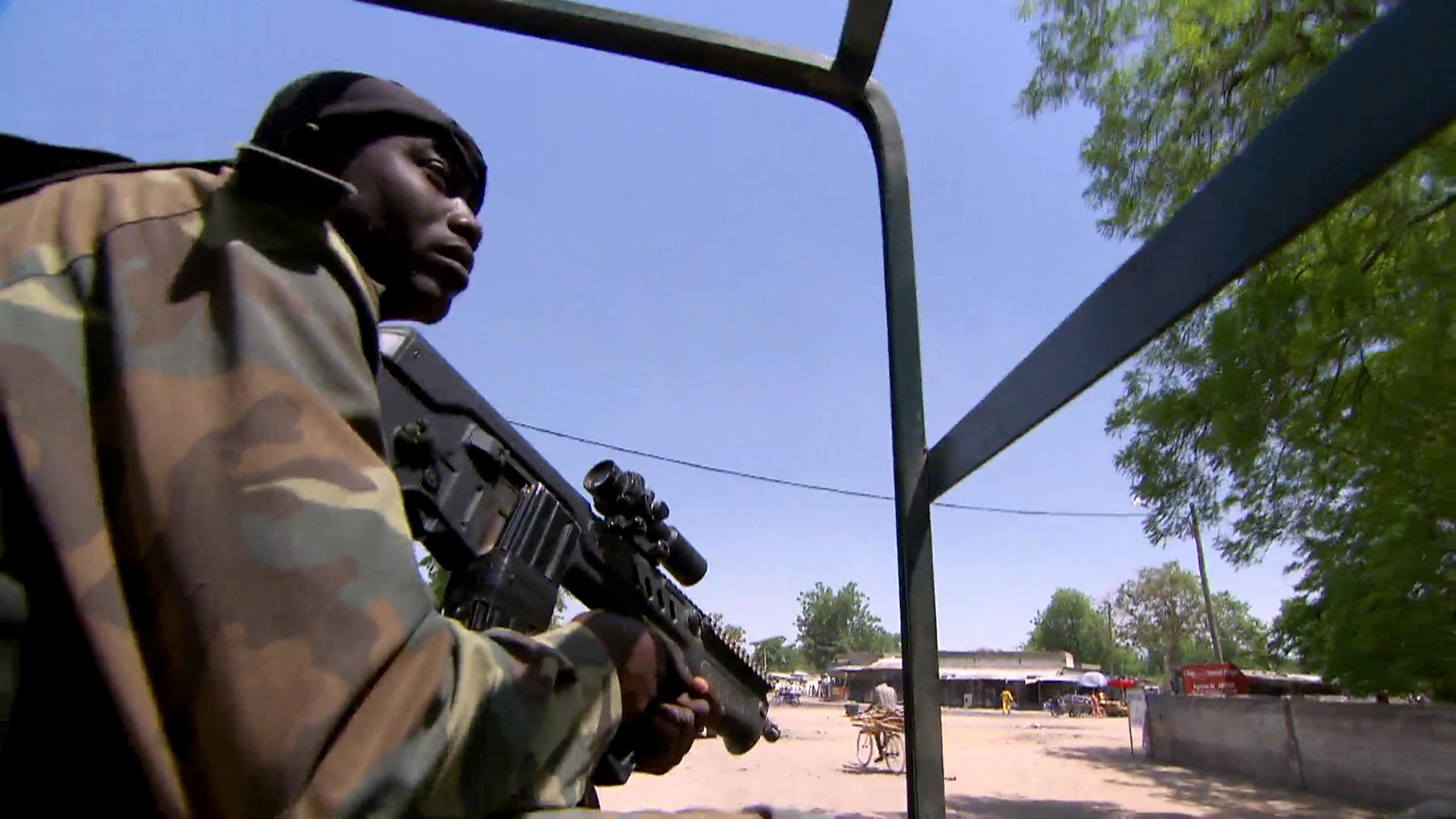 Image: A soldier patrols a village in Cameroon