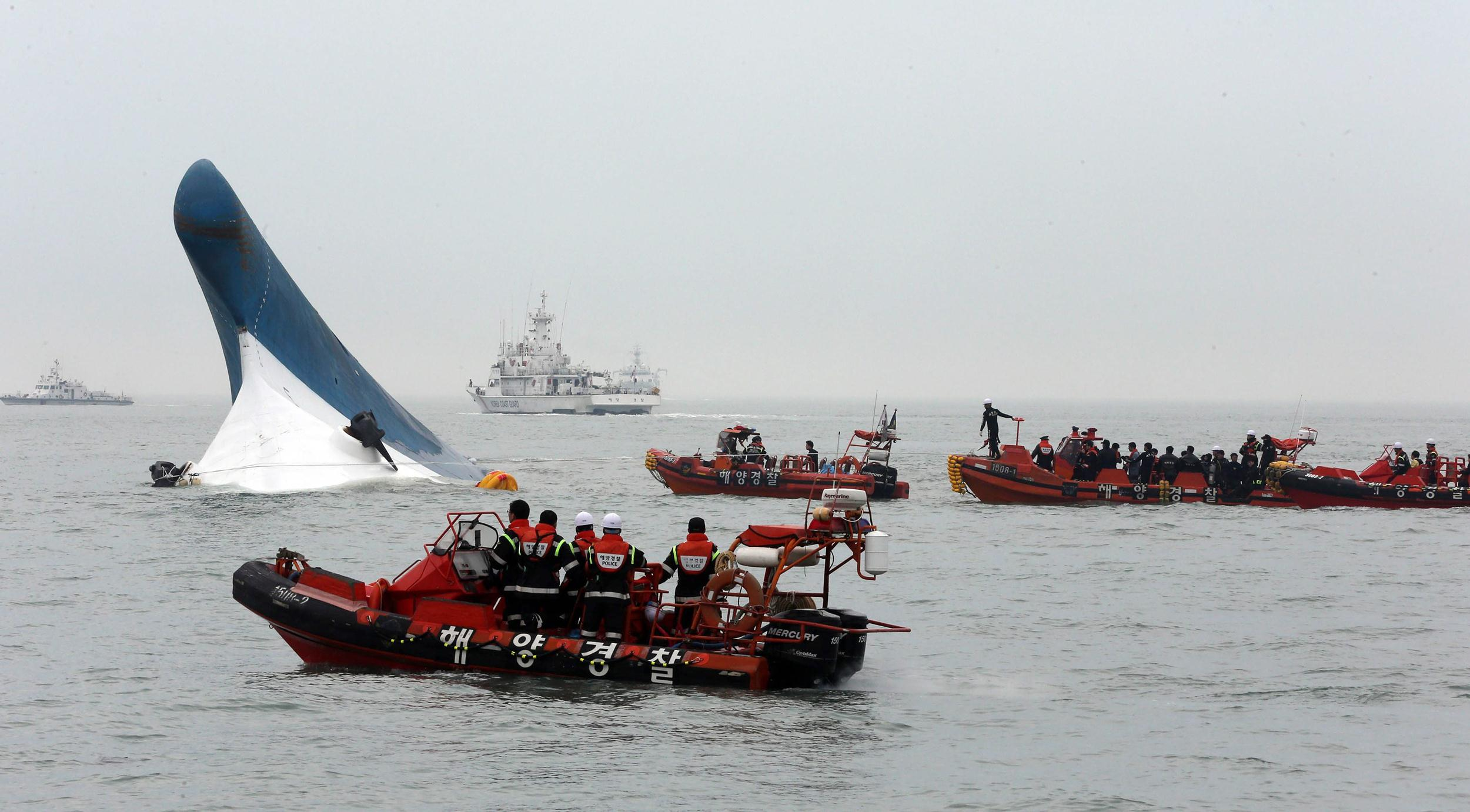 Image: South Korean Coast Guard officers conduct a last-minute rescue operation around the passenger ferry Sewol sinking in waters off the southwestern coast of South Korea, April 16.