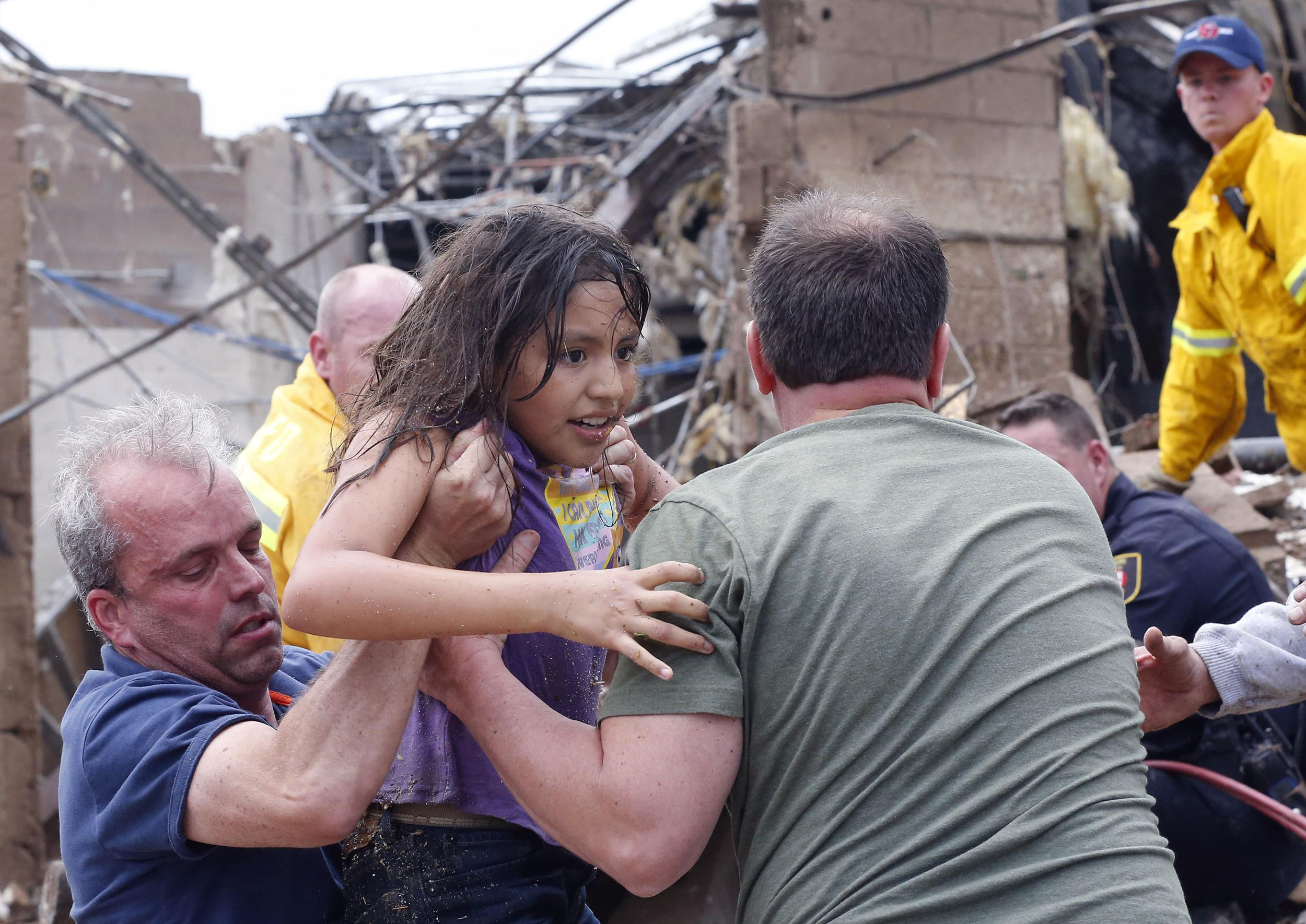 Image: A child is pulled from the rubble of the Plaza Towers Elementary