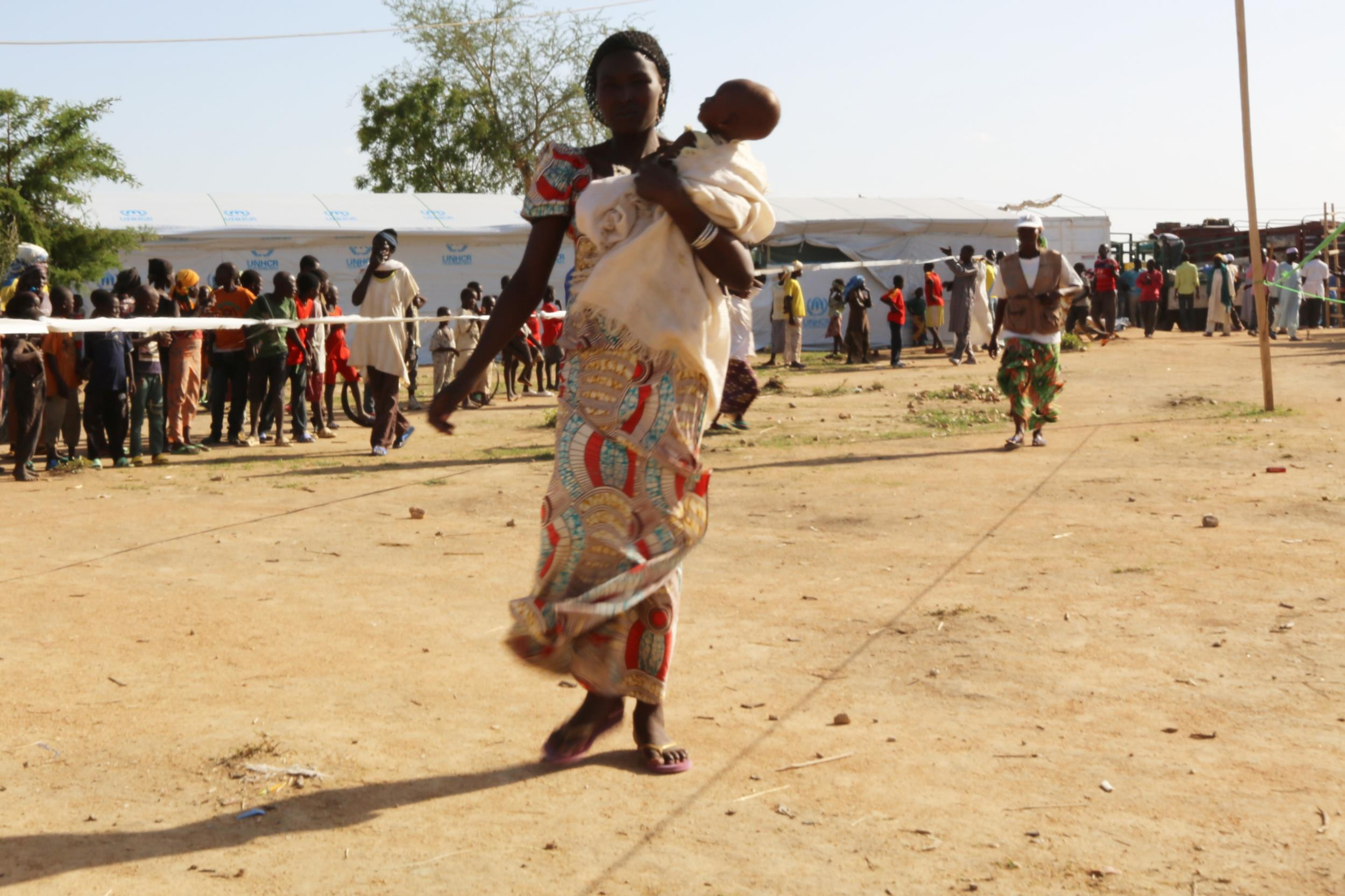 Nigerians fleeing Boko Haram violence arrive at the Minawao Camp across the border in Cameroon.