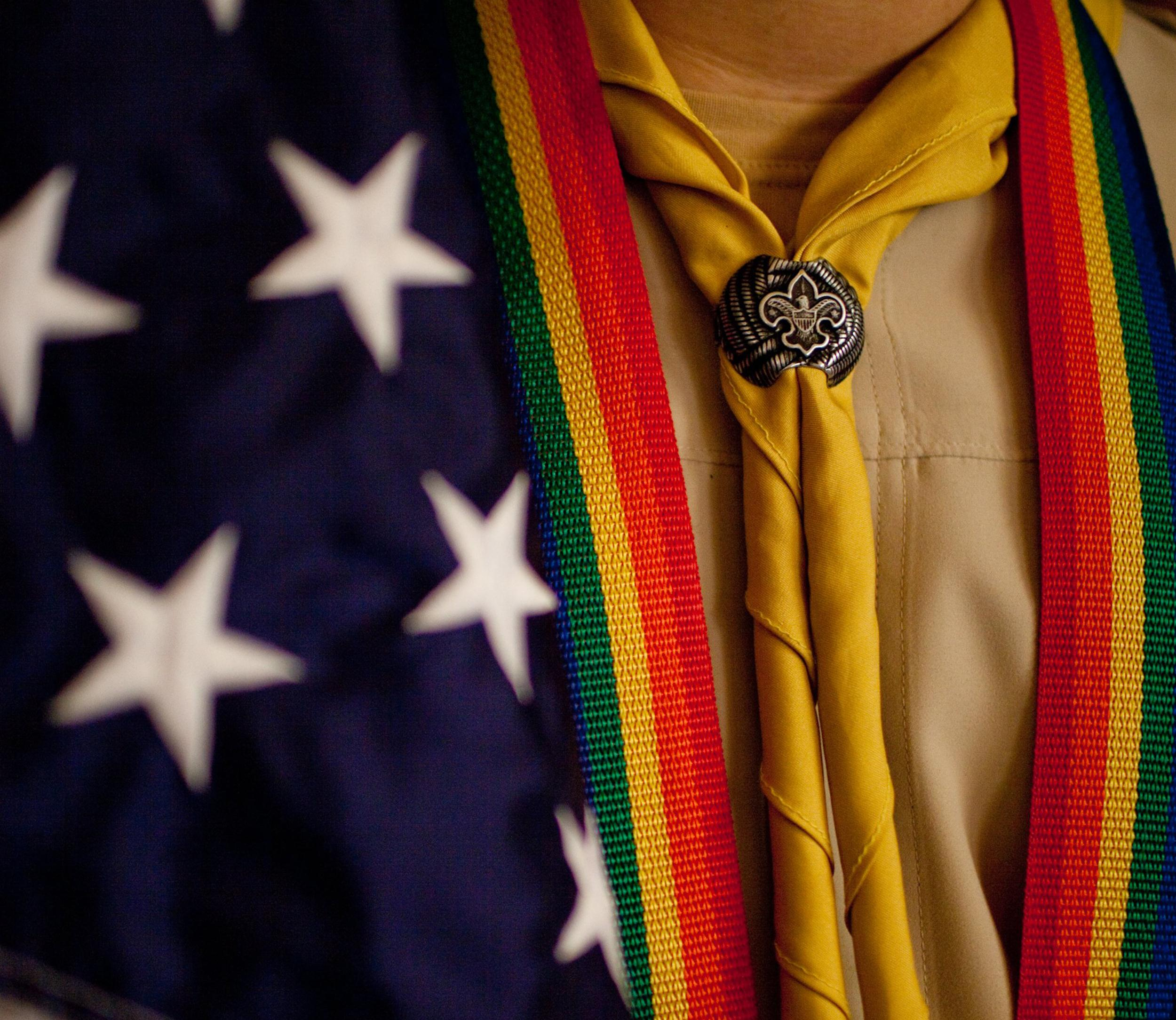 Image: Boy Scout Travis Beach holds the American Flag