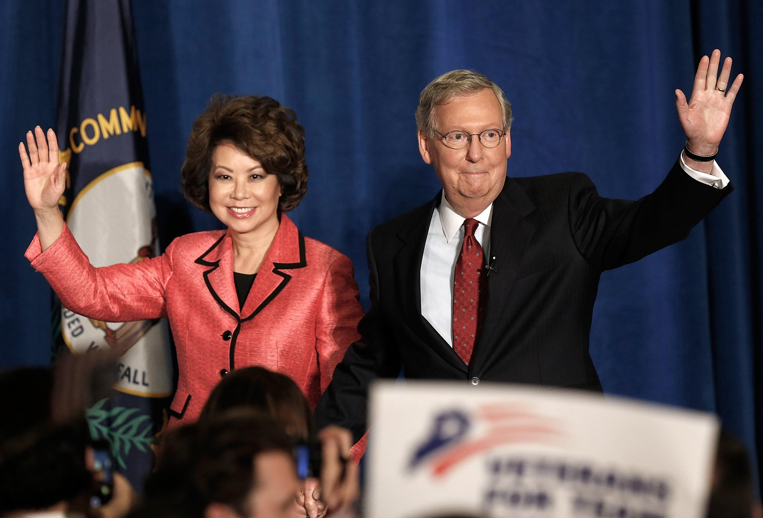 Image: U.S. Senate Republican Leader Sen. Mitch McConnell (R-KY) and his wife Elaine Chao arrive for a victory celebration following the early results of the state Republican primary