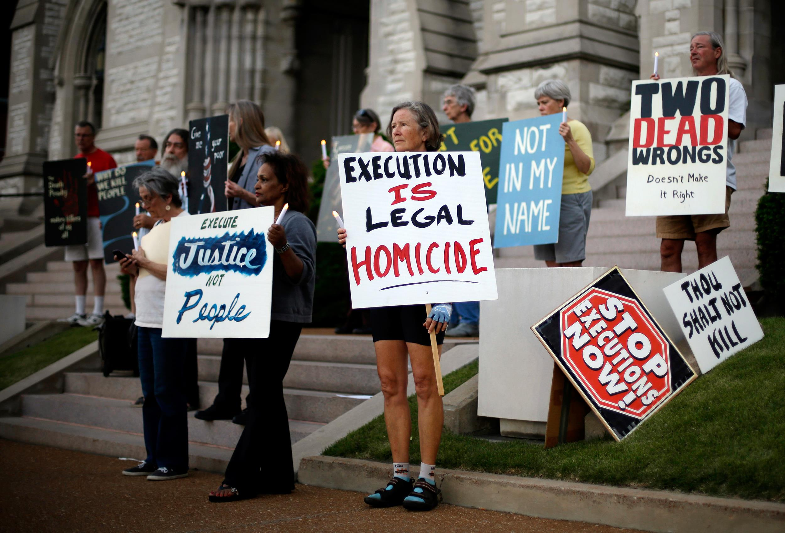 Image: Death penalty opponents participate in a vigil with others outside St. Francis Xavier College Church hours before the scheduled execution of Missouri death row inmate Russell Bucklew in St. Louis