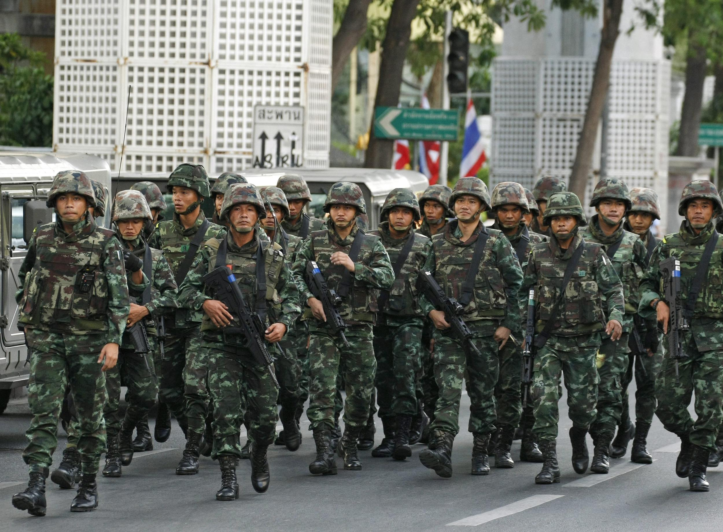 Armed Thai soldiers march in as hundreds of pro-democracy activists held a demonstration against the army coup near the Bangkok Art and Culture Center (BACC).