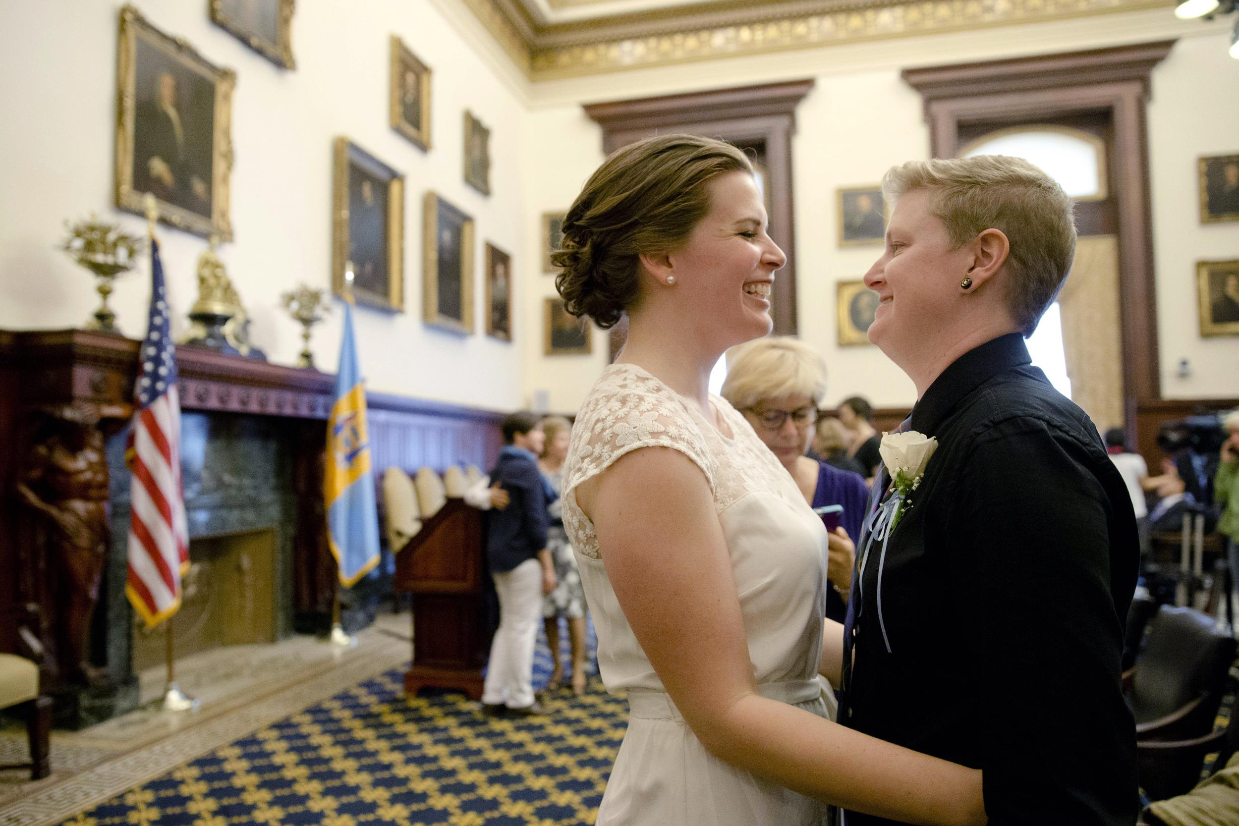 Image: Corey Crawford, right, and Jessica Samph smile to each other before their wedding at City Hall in Philadelphia