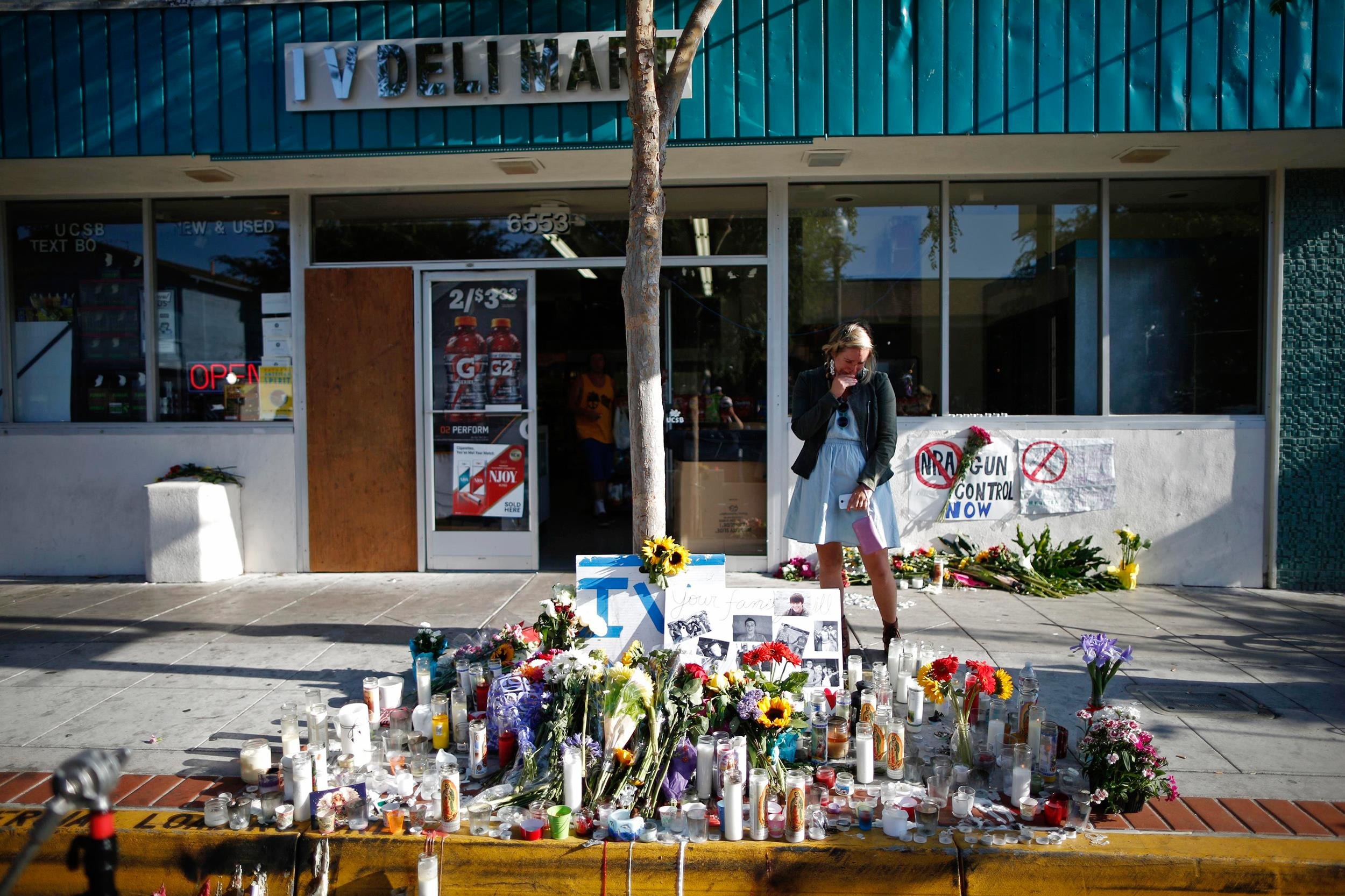 Image: A woman cries in front of a makeshift memorial for UCSB student Christopher Michael-Martinez in Isla Vista