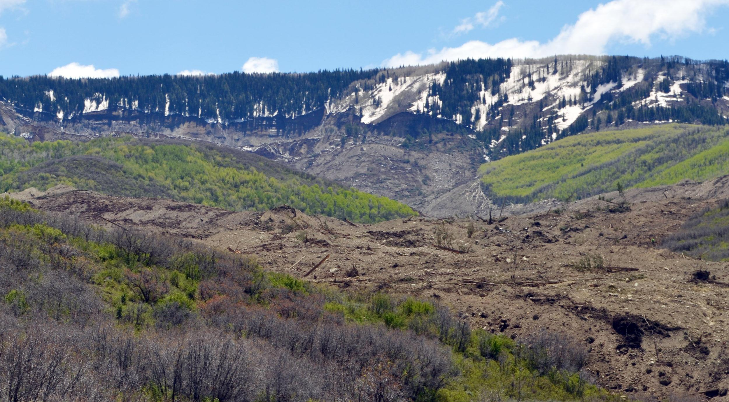 Image: The results of a three-mile long mudslide are piled below Grand Mesa