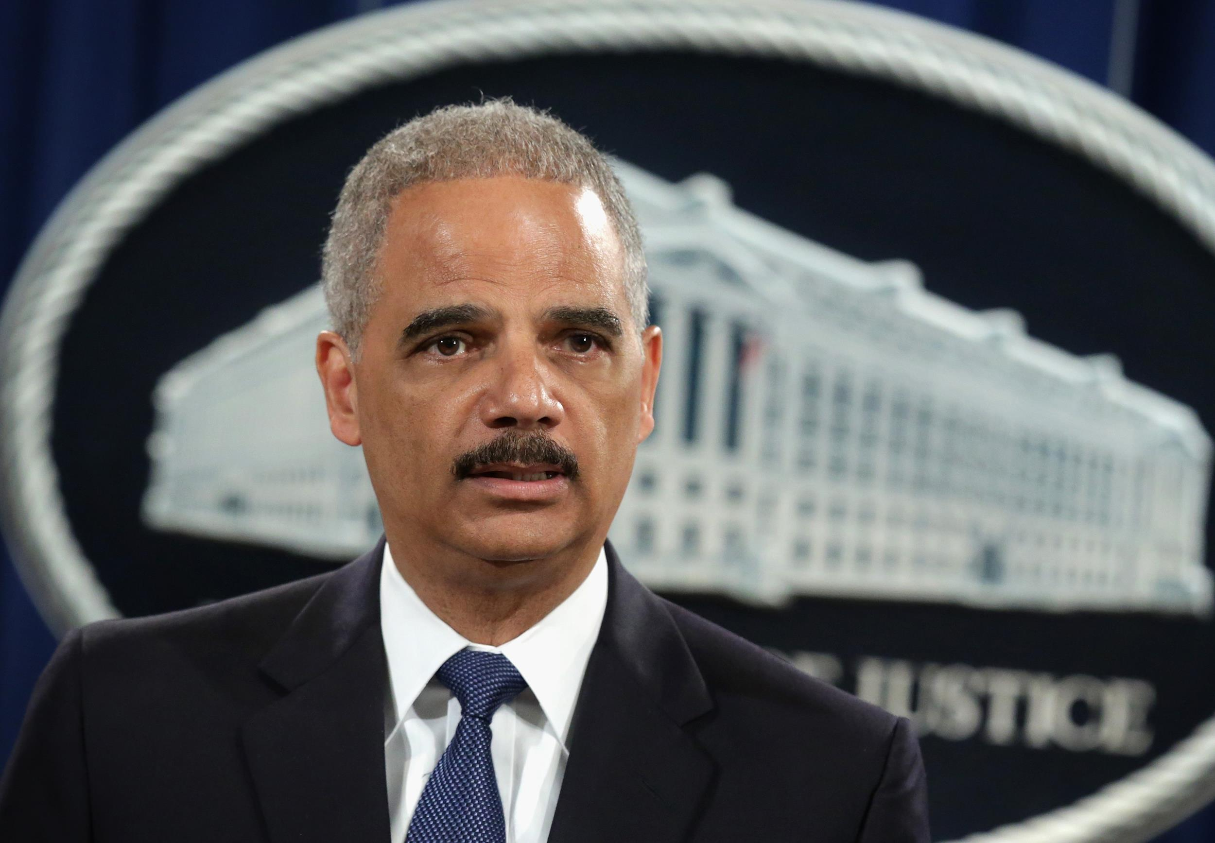 Image: U.S. Attorney General Eric Holder speaks as on May 19 at the Department of Justice in Washington, DC