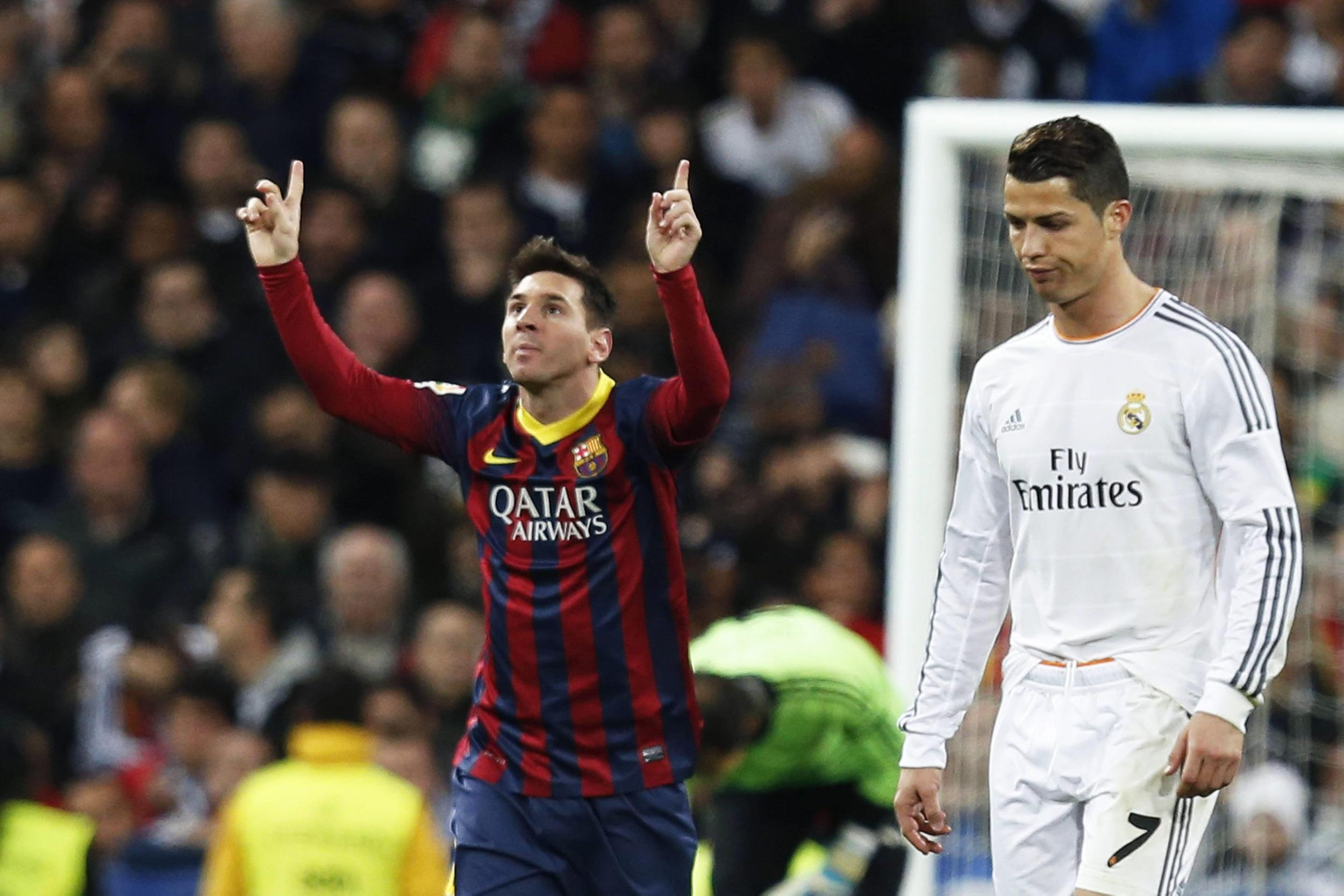 Cristiano Ronaldo (R) and Lionel Messi (L) are the faces of the Nike-Adidas soccer marketing rivalry.