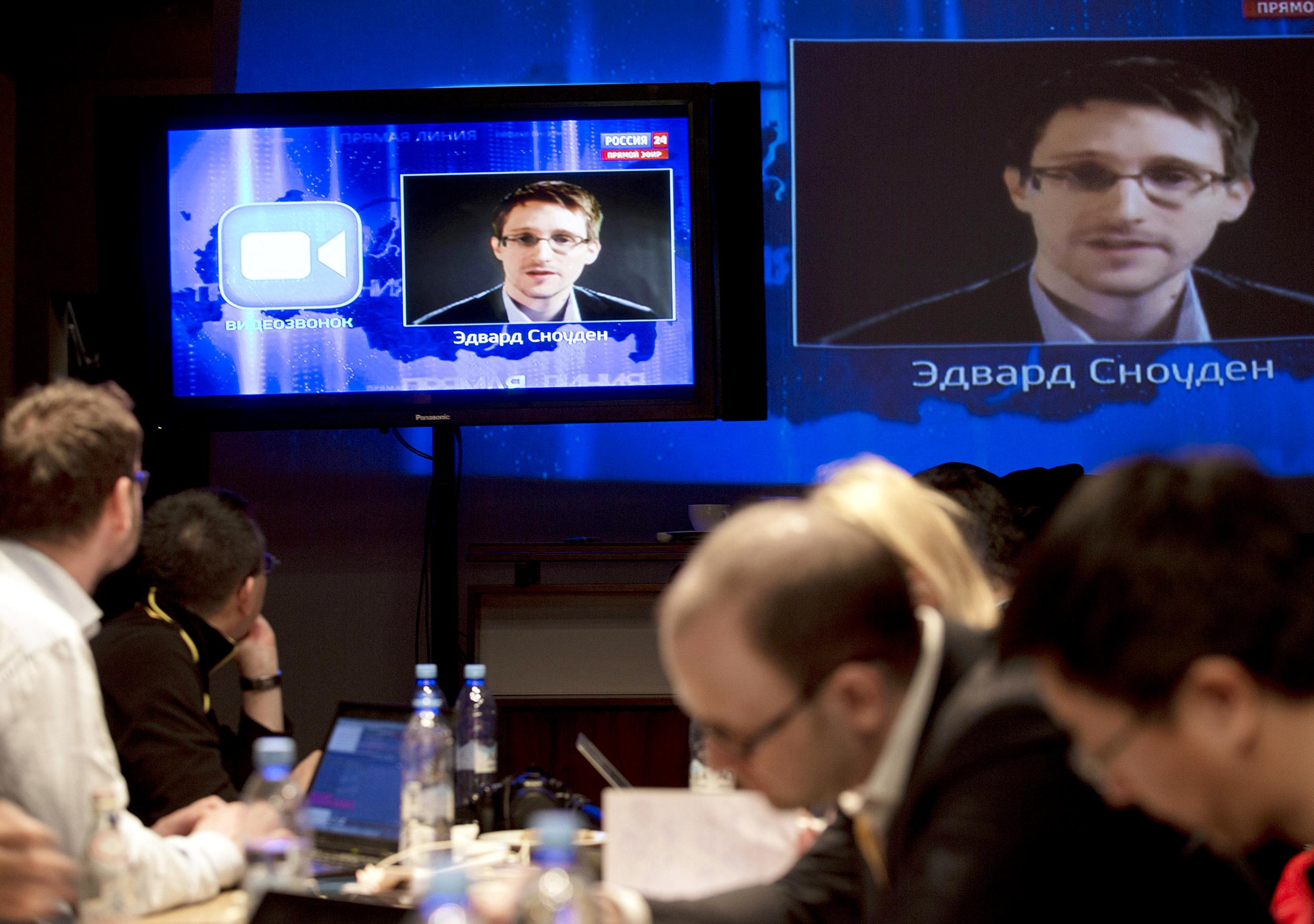 Image: Vladimir Putin, Edward Snowden
