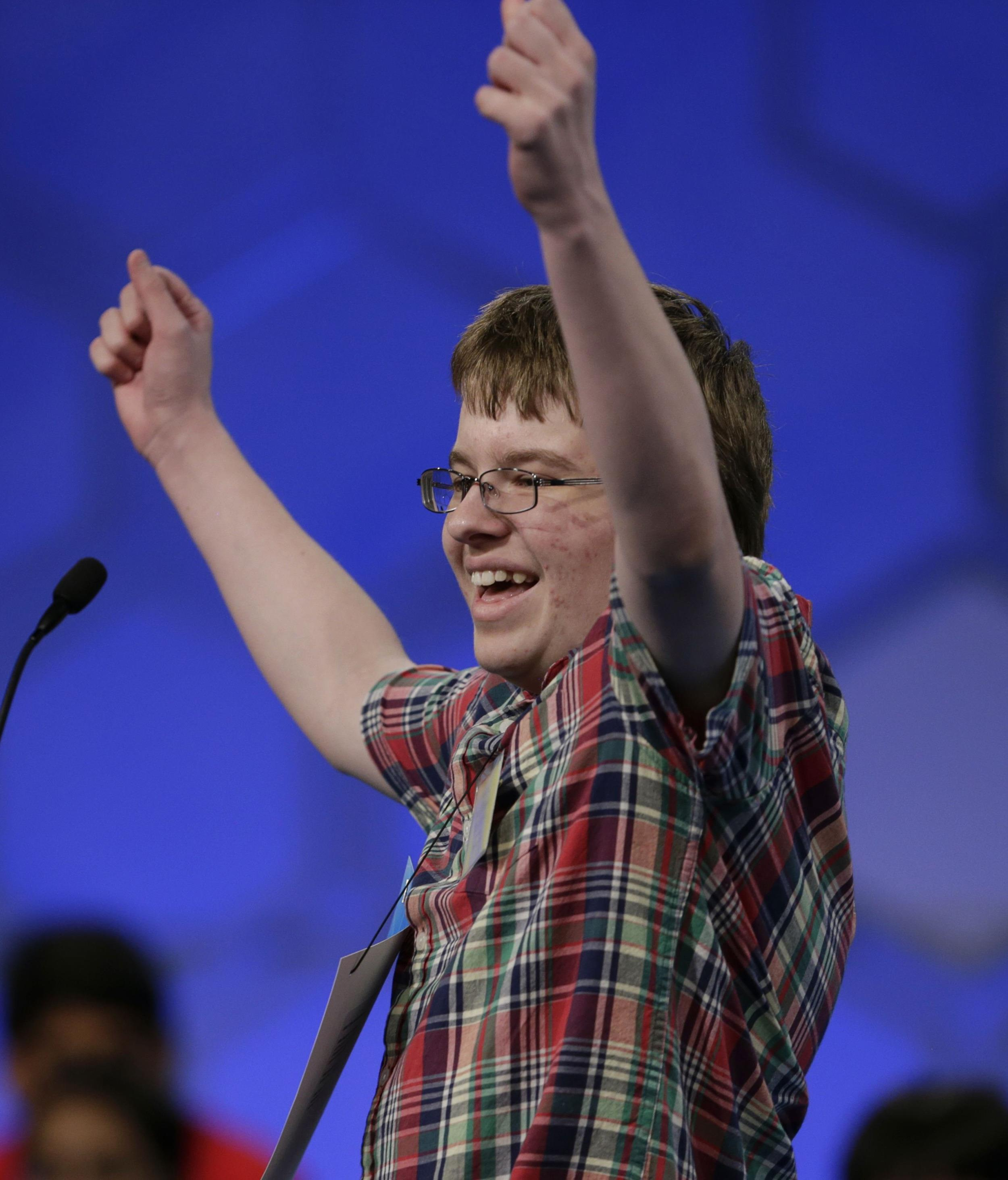 Image: Jacob Williamson celebrates the correct spelling of his word during the semifinals of the 87th annual Scripps National Spelling Bee at National Harbor, Maryland