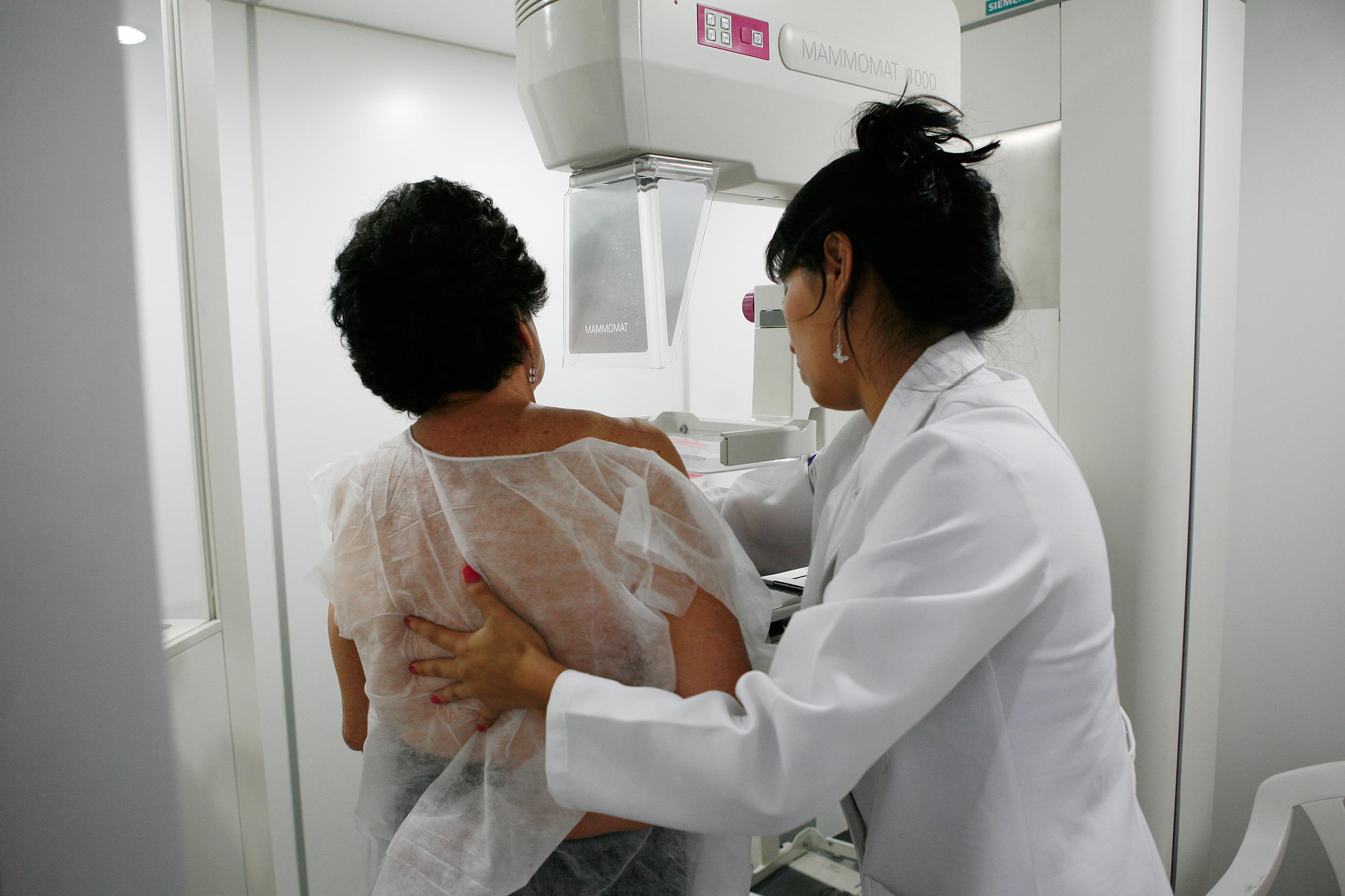 Image: A woman undergoes a mammogram
