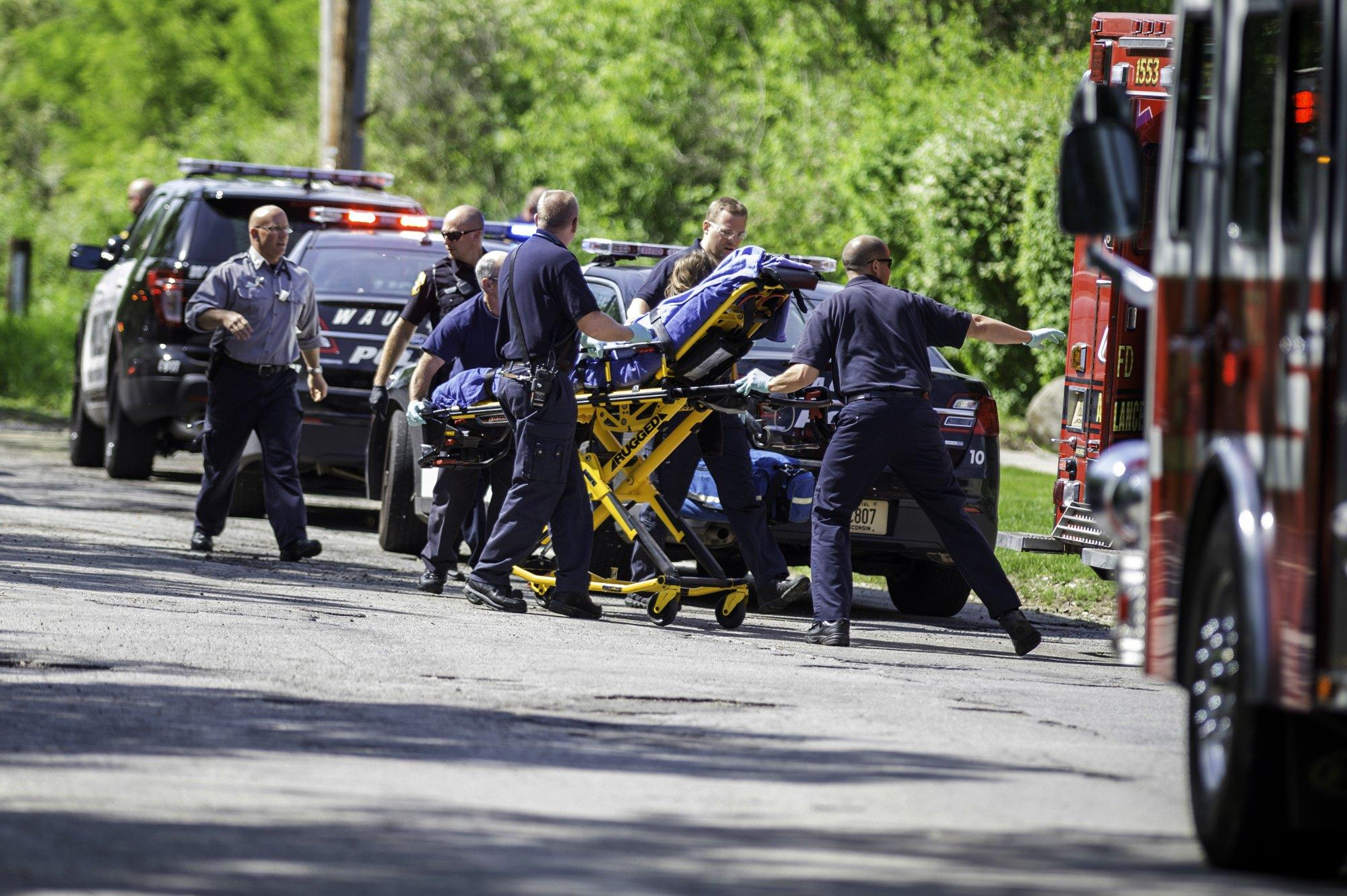 Image: Rescue workers take a stabbing victim to the ambulance in Waukesha, Wis., on May 31