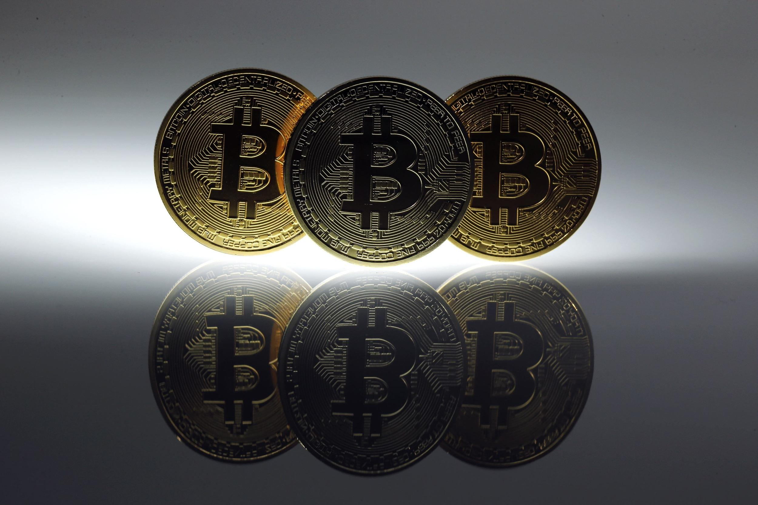 Mock Bitcoins are displayed on a table in an illustration picture taken in Berlin in this January 7, 2014 file photo.