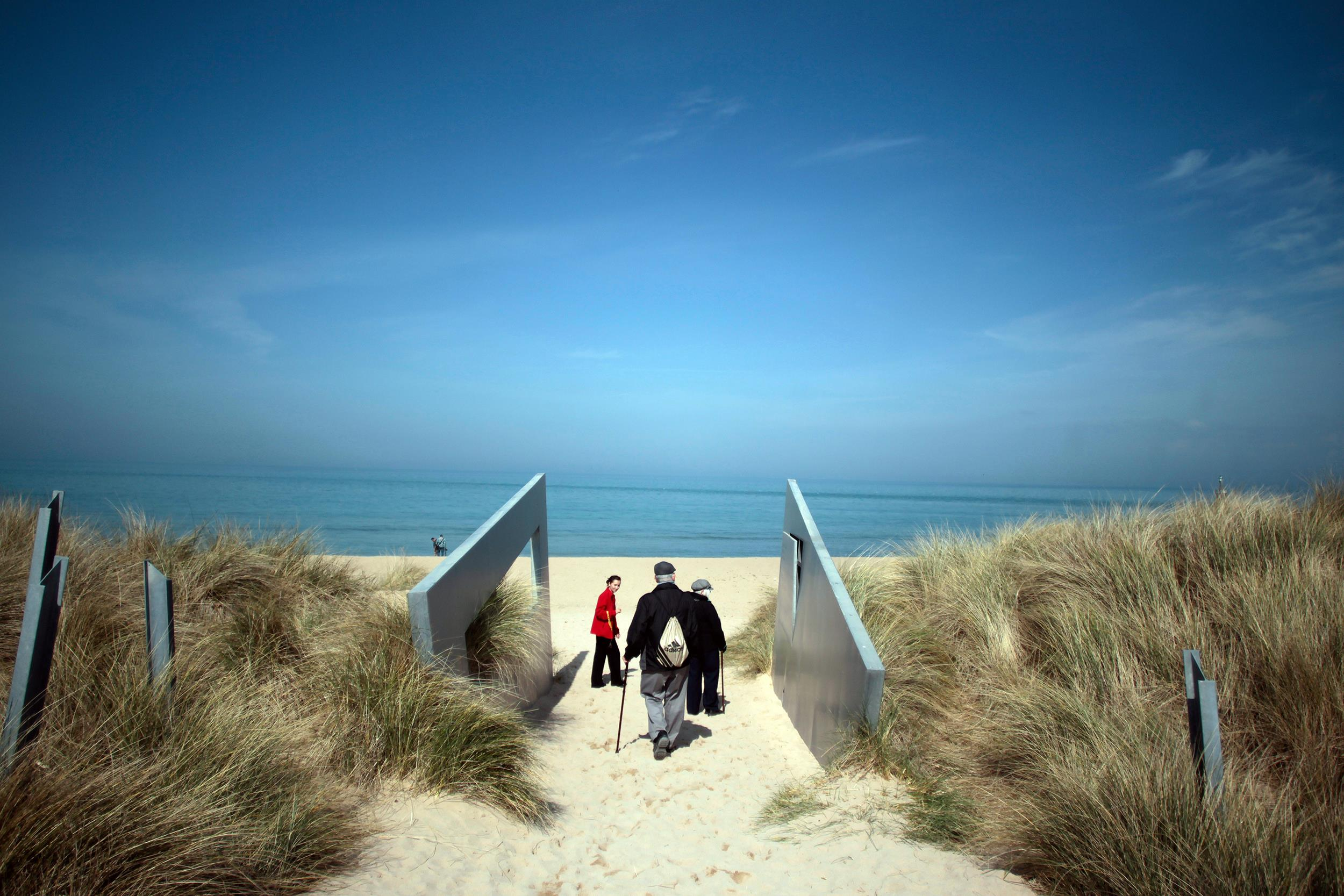 Image: Tourists visit the Juno Beach with a guide near the Juno Beach Museum on April 1 in Courseulles-sur-Mer, western France