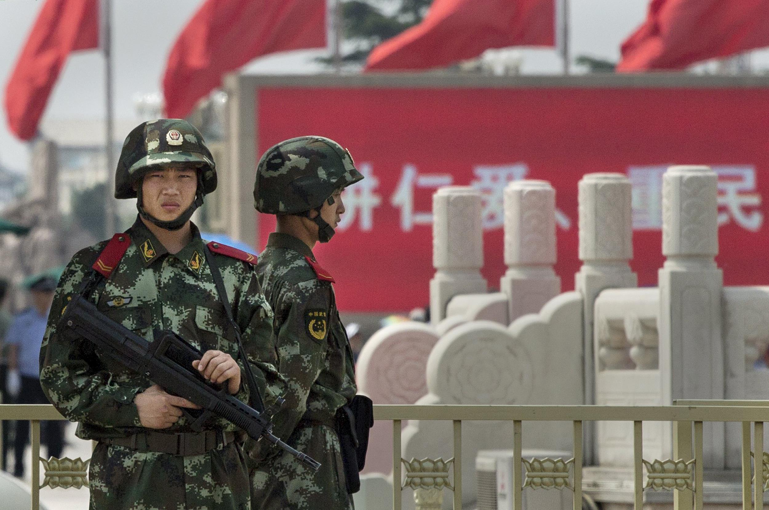 Image: Chinese paramilitary police stand guard in Tiananmen Square