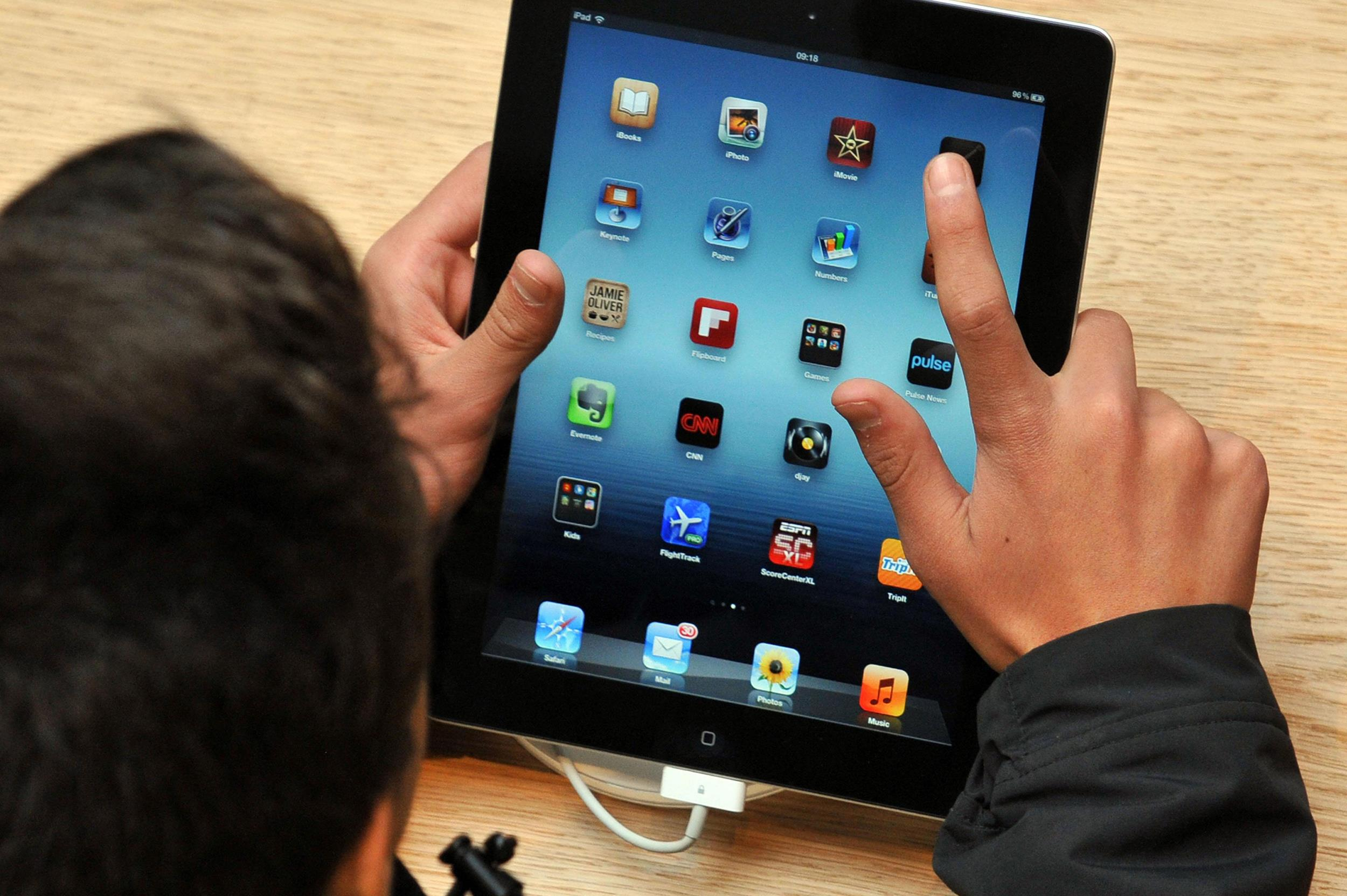 Image: A child n using an iPad