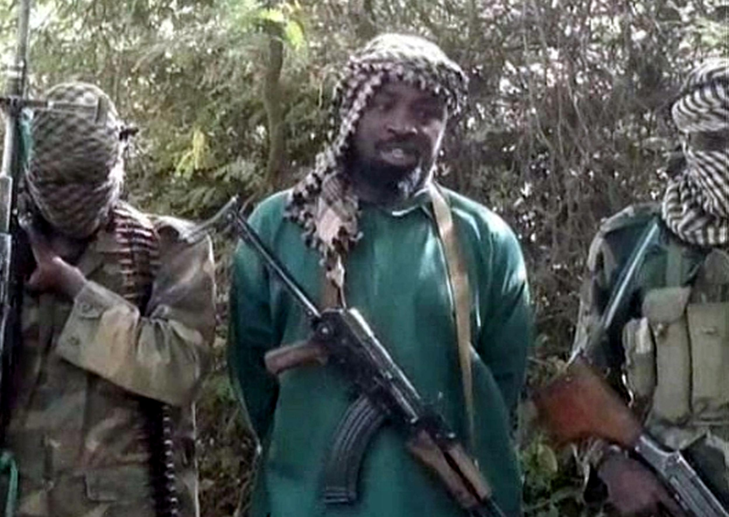 Image: Abubakar Shekau, center, the suspected leader of Nigerian Islamist extremist group Boko Haram