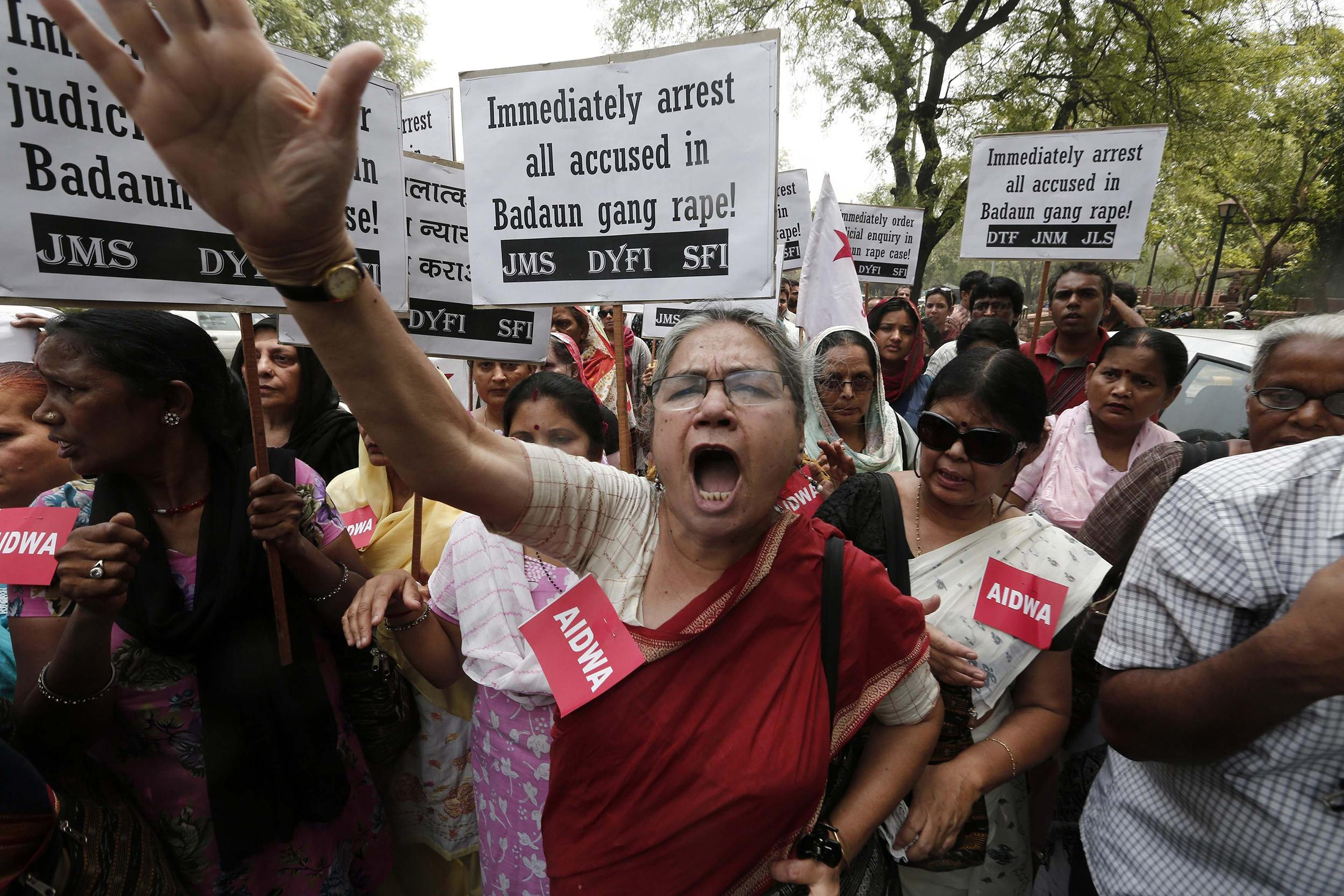 Image: Demonstrators from AIDWA hold placards and shout slogans during protest against recent killings of two teenage girls, in New Delhi