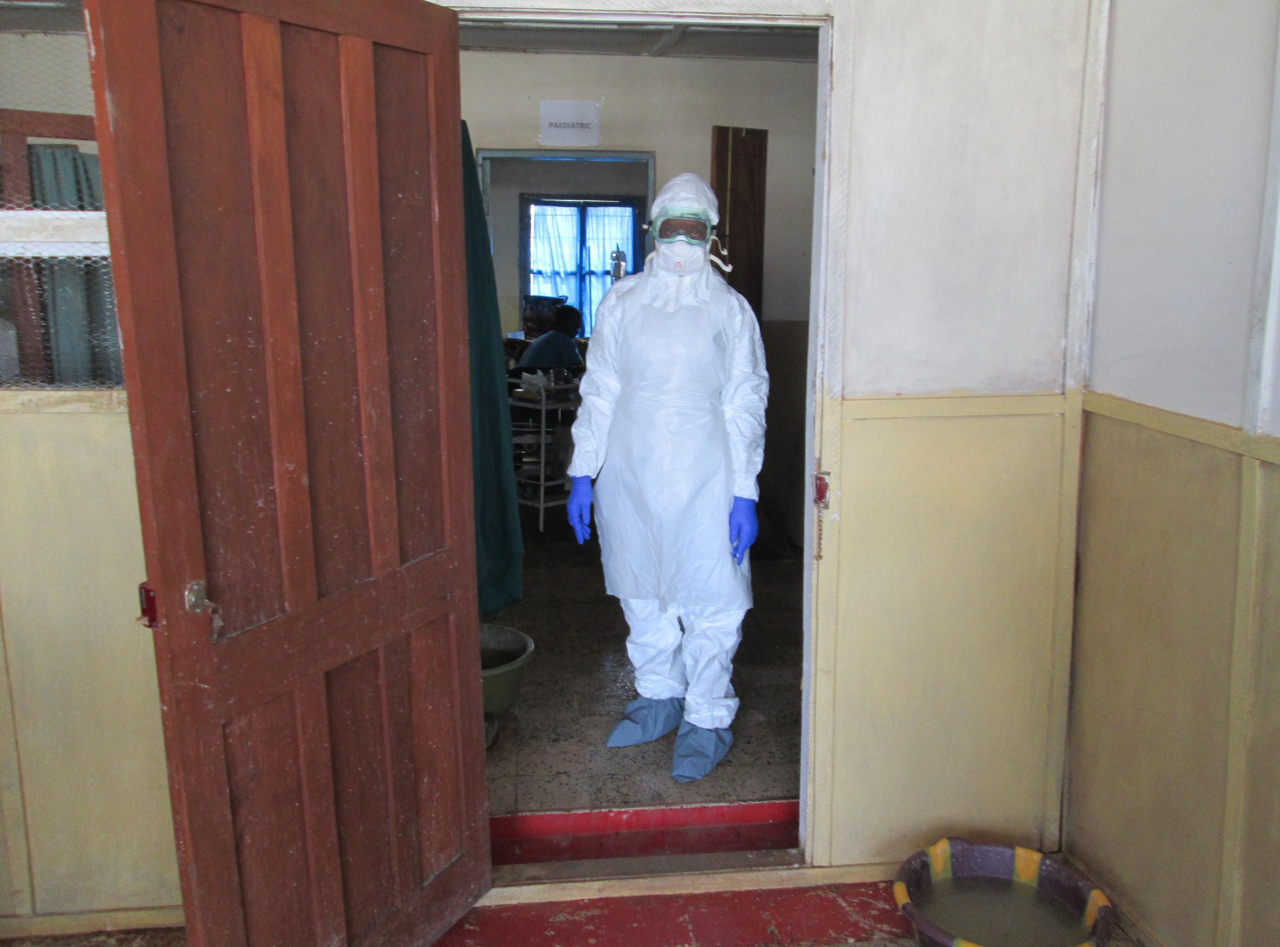 Nurse Veronica Koroma stands in the doorway of the Viral Hemorrhagic Fever (VHF)  ward at Kenema Government Hospital in Sierra Leone.