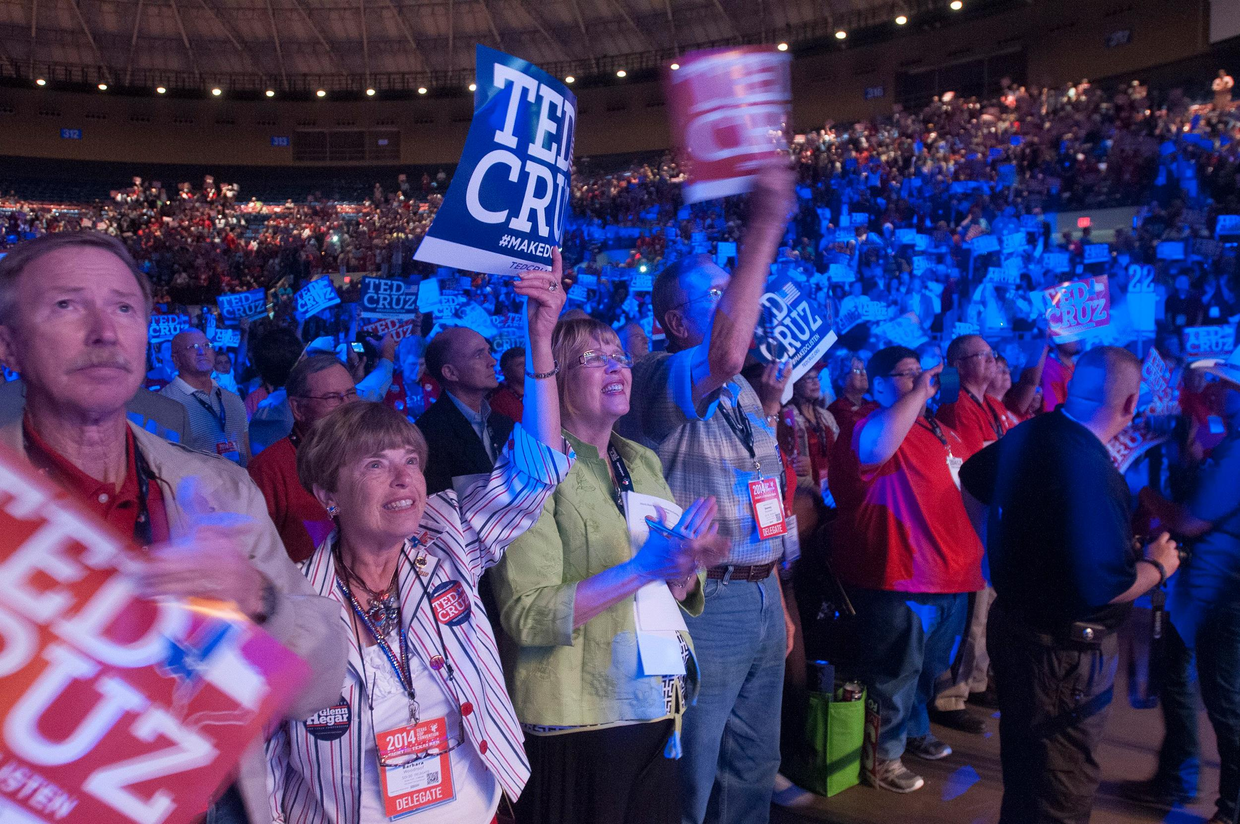 Image: Delegates to the Texas Republican Convention cheer Texas Sen. Ted Cruz during his speech in Fort Worth, Texas