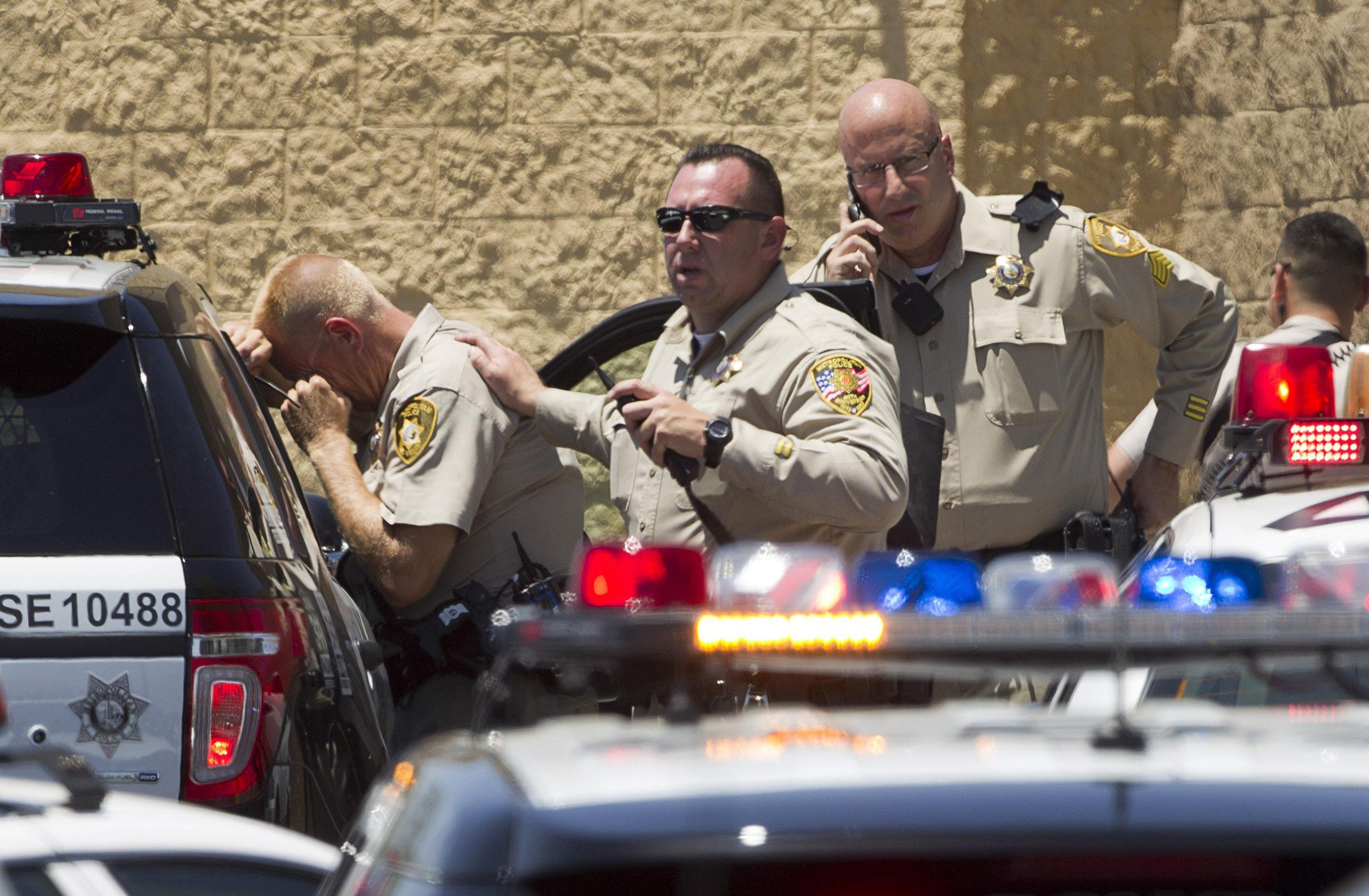 Image: Metro Police officers stand outside a Wal-Mart after a shooting in Las Vegas