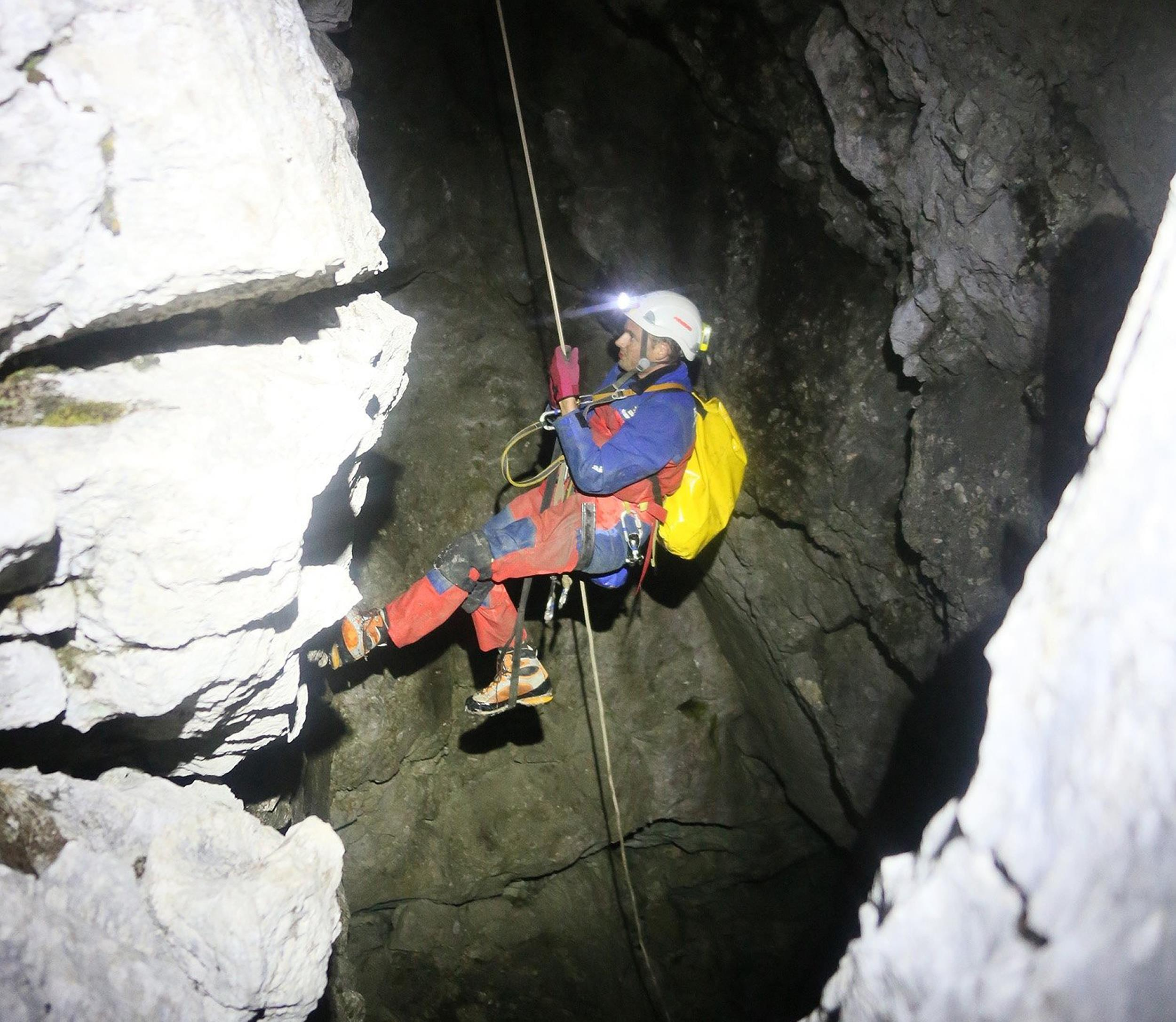 Image: A rescuer enters a cave near Berchtesgaden, Germany