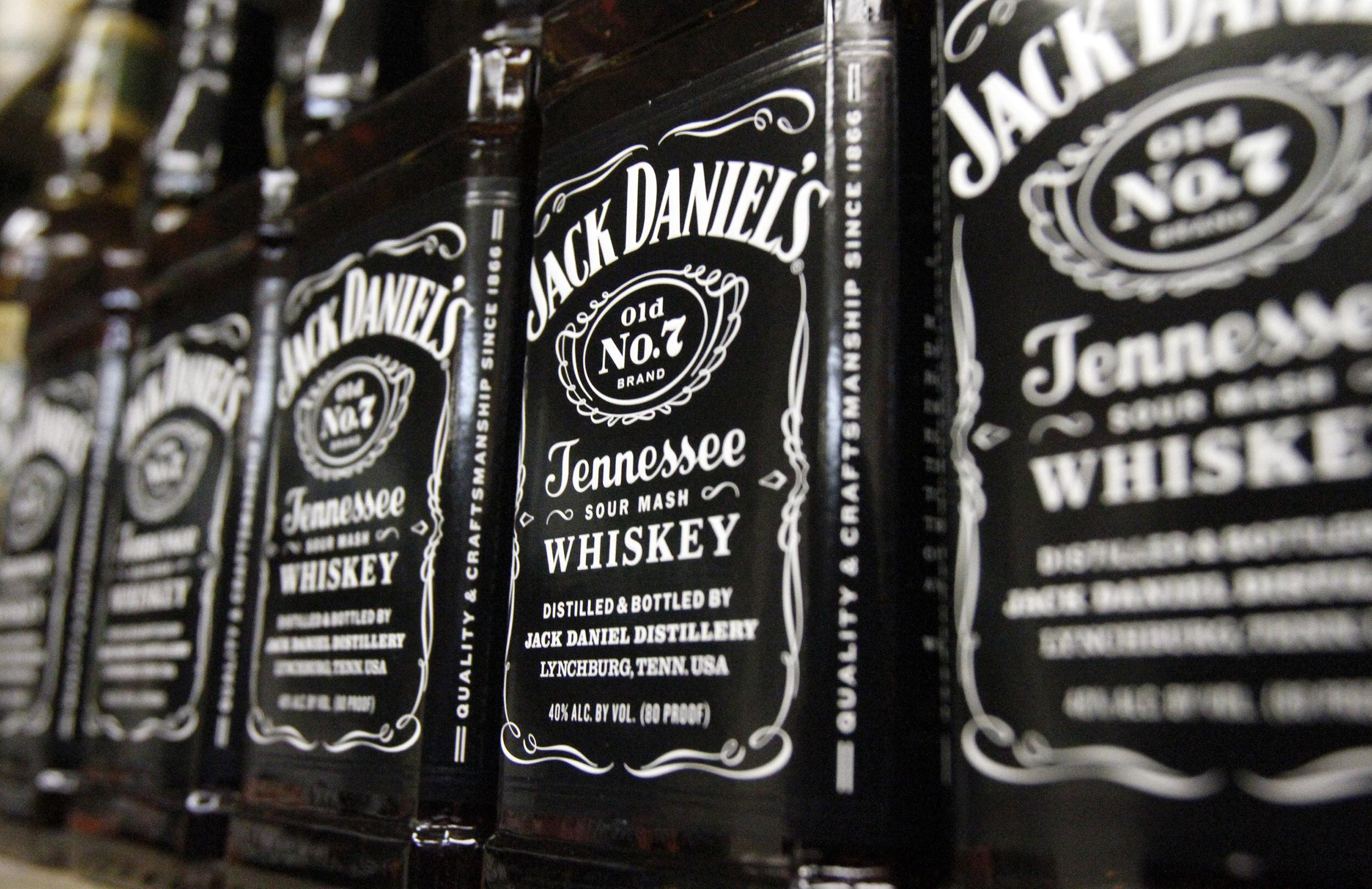 Image: Bottles of Jack Daniel's Tennessee Whiskey, line the shelves of a liquor outlet, in Montpelier, Vt. on Dec. 5, 2011