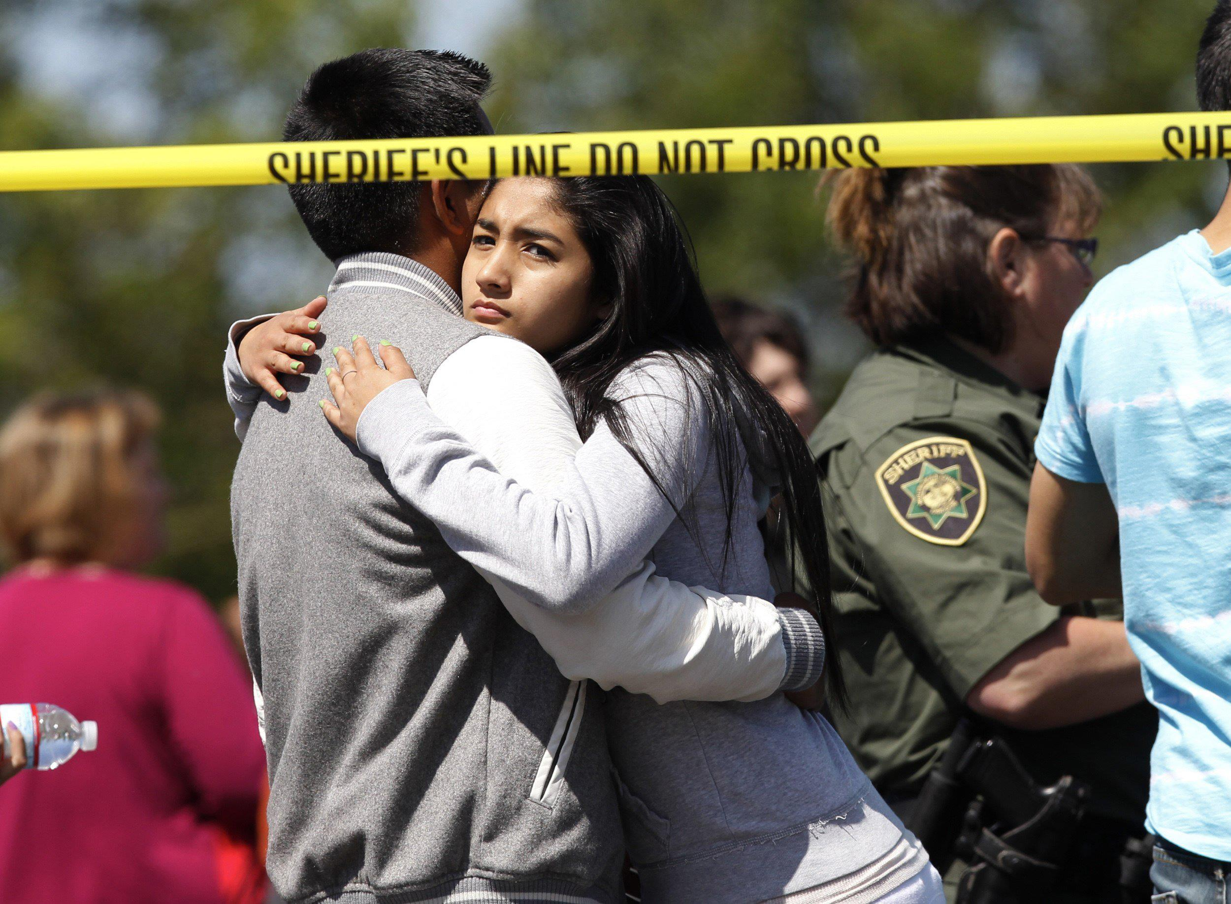 Image: Parents and students are reunited after a shooting at Reynolds High School in Troutdale, Oregon