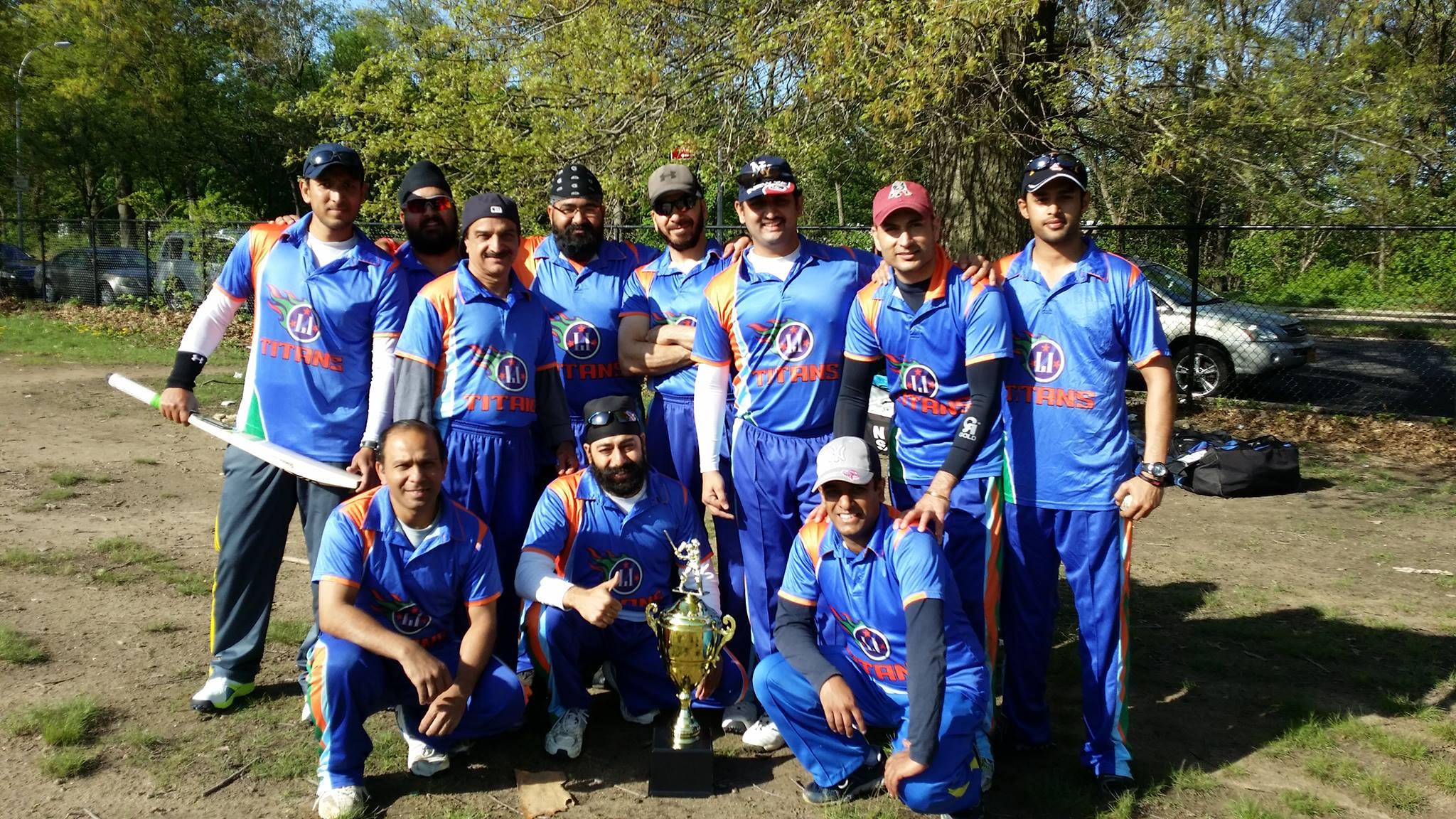 Ajith Bhaskar Shetty (standing, third from right) poses with his cricket teammates.