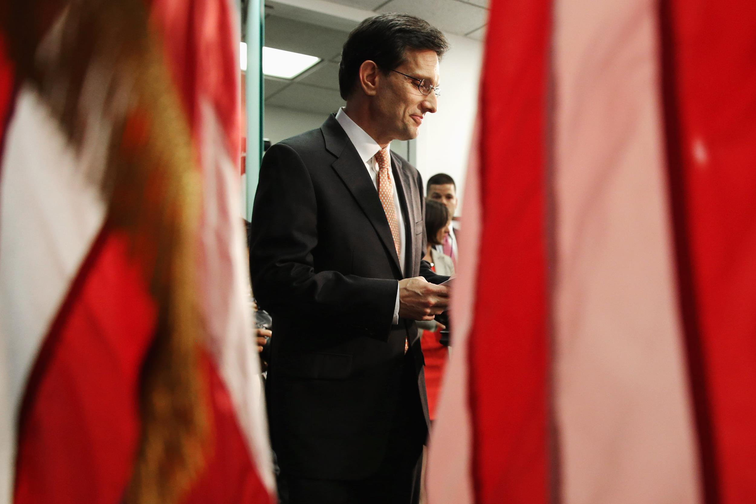 Image: House Majority Leader Eric Cantor arrives for a news conference