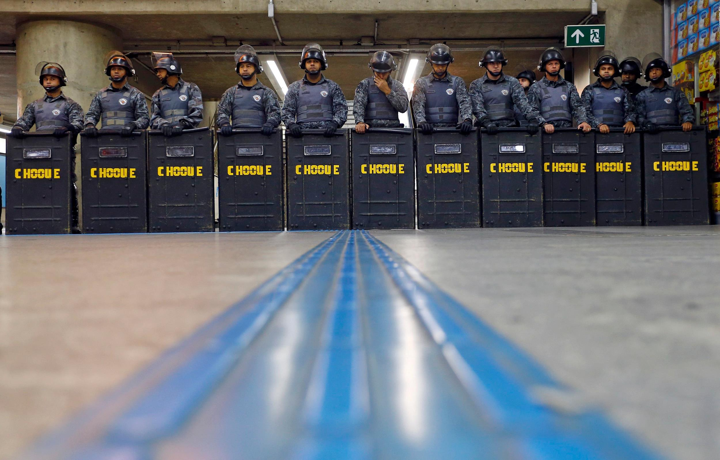 Image: Policemen in riot gear stand inside Ana Rosa subway station during the fifth day of metro worker's protest in Sao Paulo