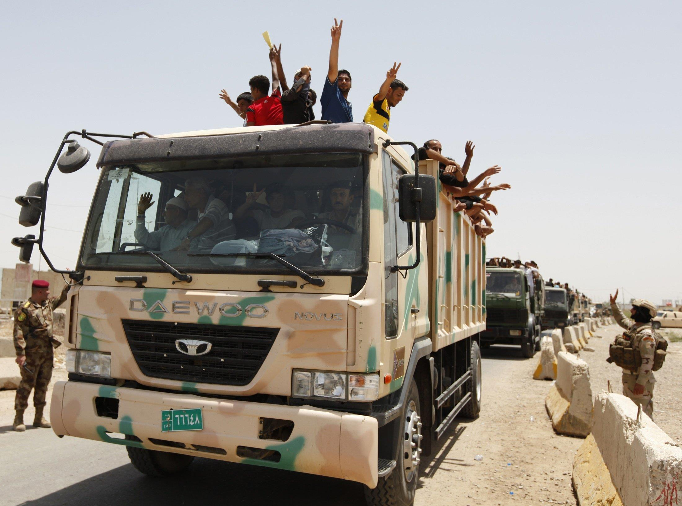 Image: Volunteers who have joined the Iraqi Army to fight against the predominantly Sunni militants, who have taken over Mosul and other Northern provinces, travel in an army truck, in Baghdad