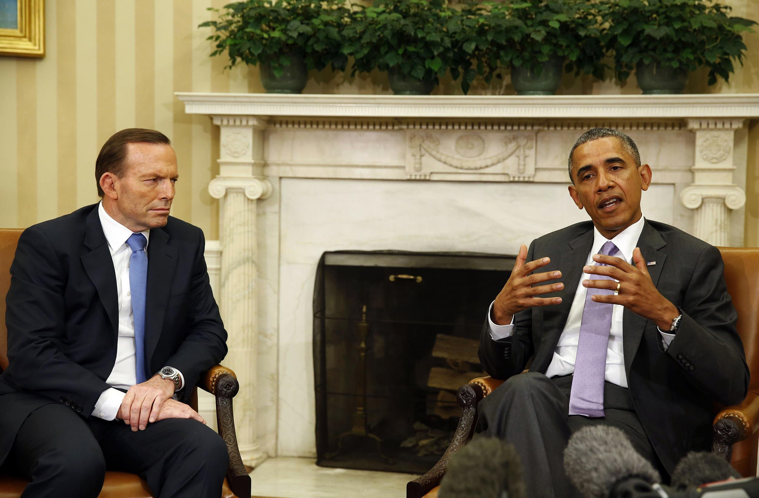 Image: U.S. President Obama speaks next to Australian PM Abbott at the White House in Washington