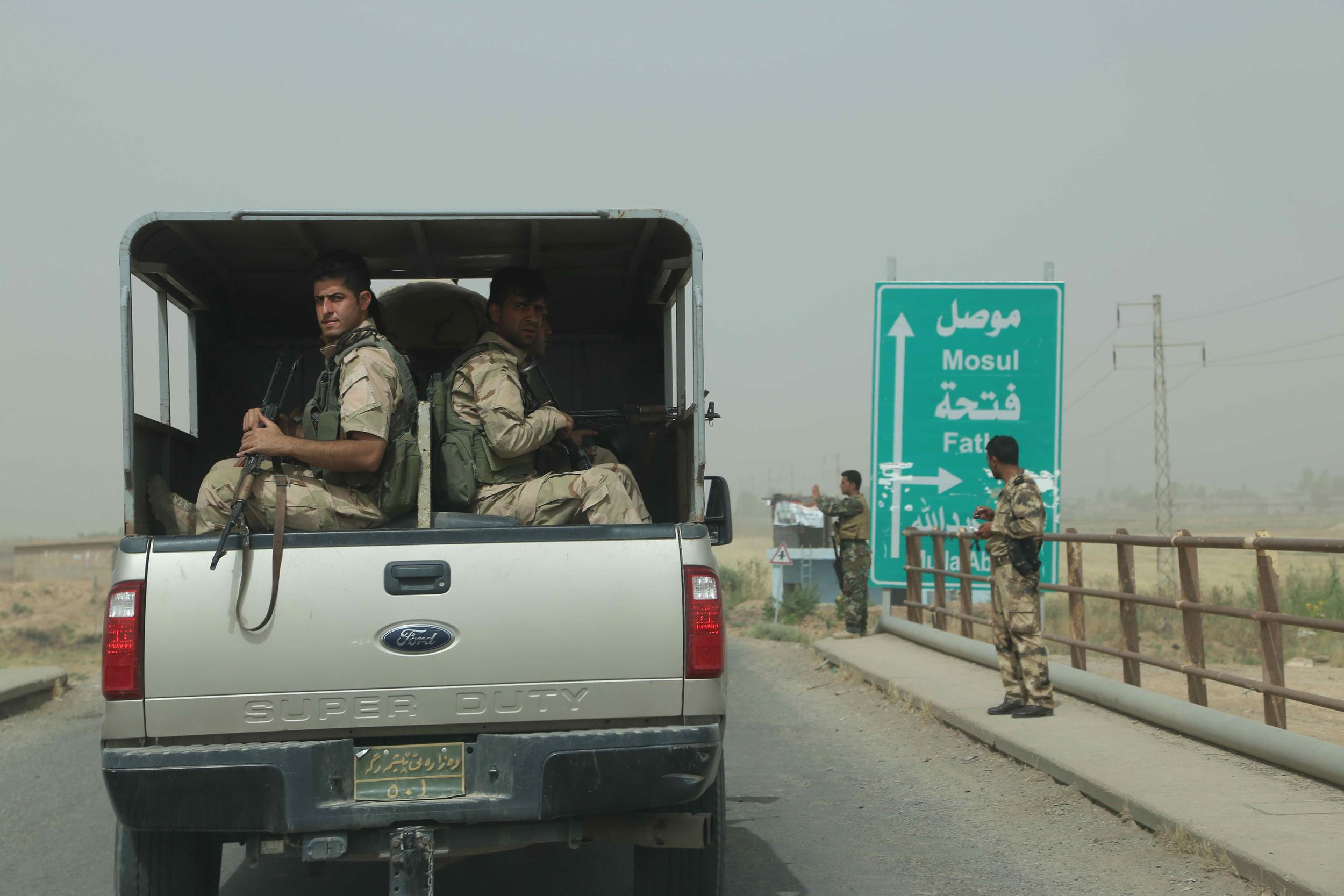 Stocks fell on Thursday as oil prices rose because of fighting in Iraq. Troops were deployed outside of the oil-rich city of Kirkuk, which was attacked by militants.