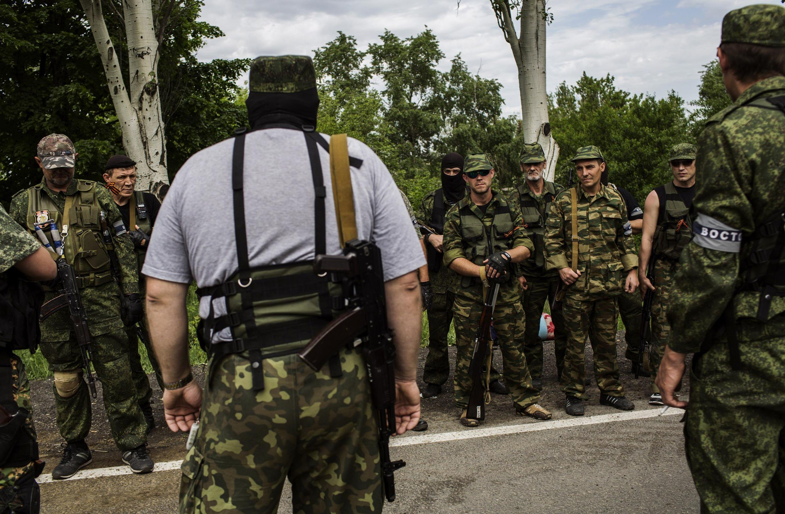 Image: Pro-Russian militants listen to instructions during a briefing