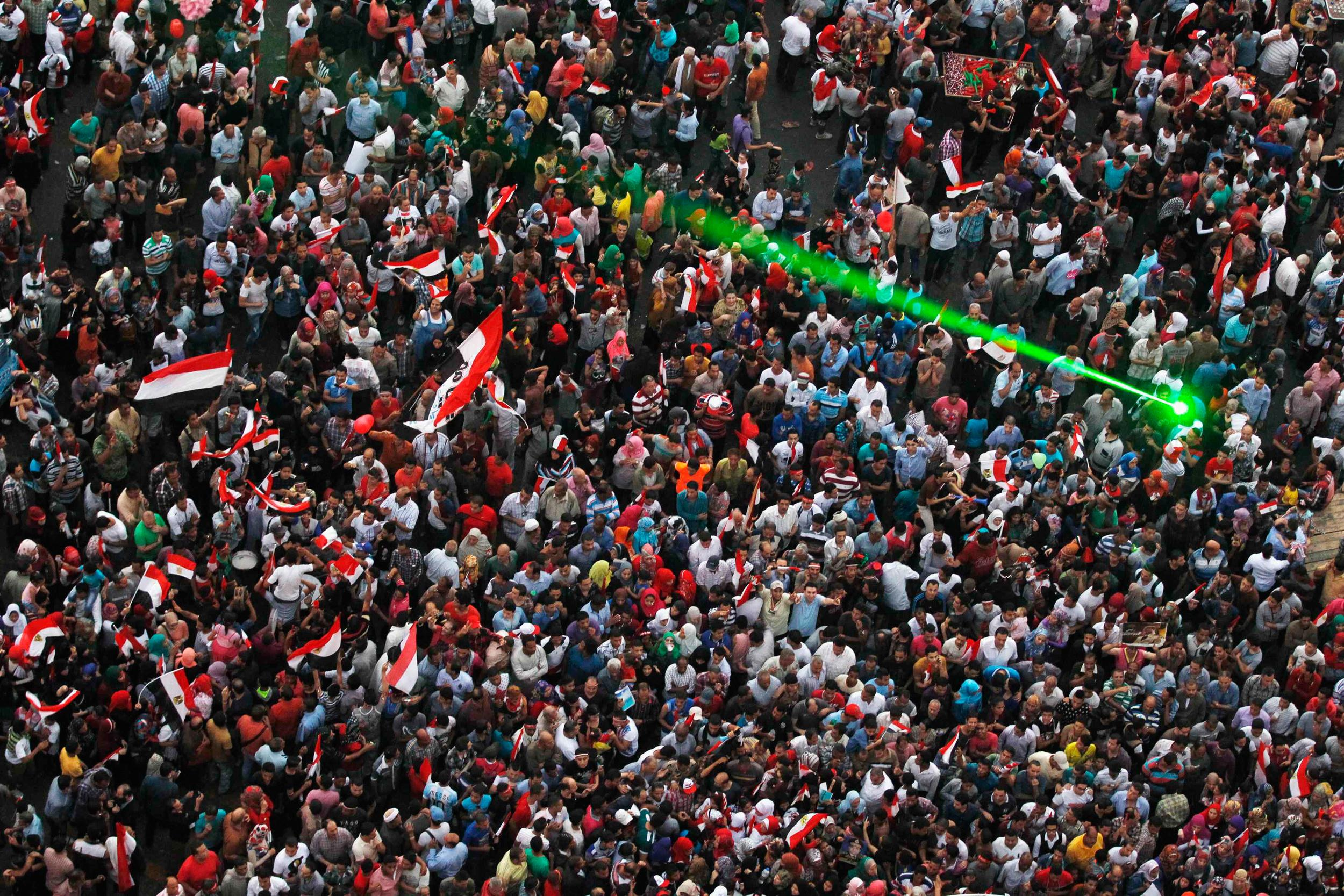 Image: Egyptians celebrate after swearing-in ceremony of president elect Abdel Fattah al-Sissi in Tahrir square in Cairo