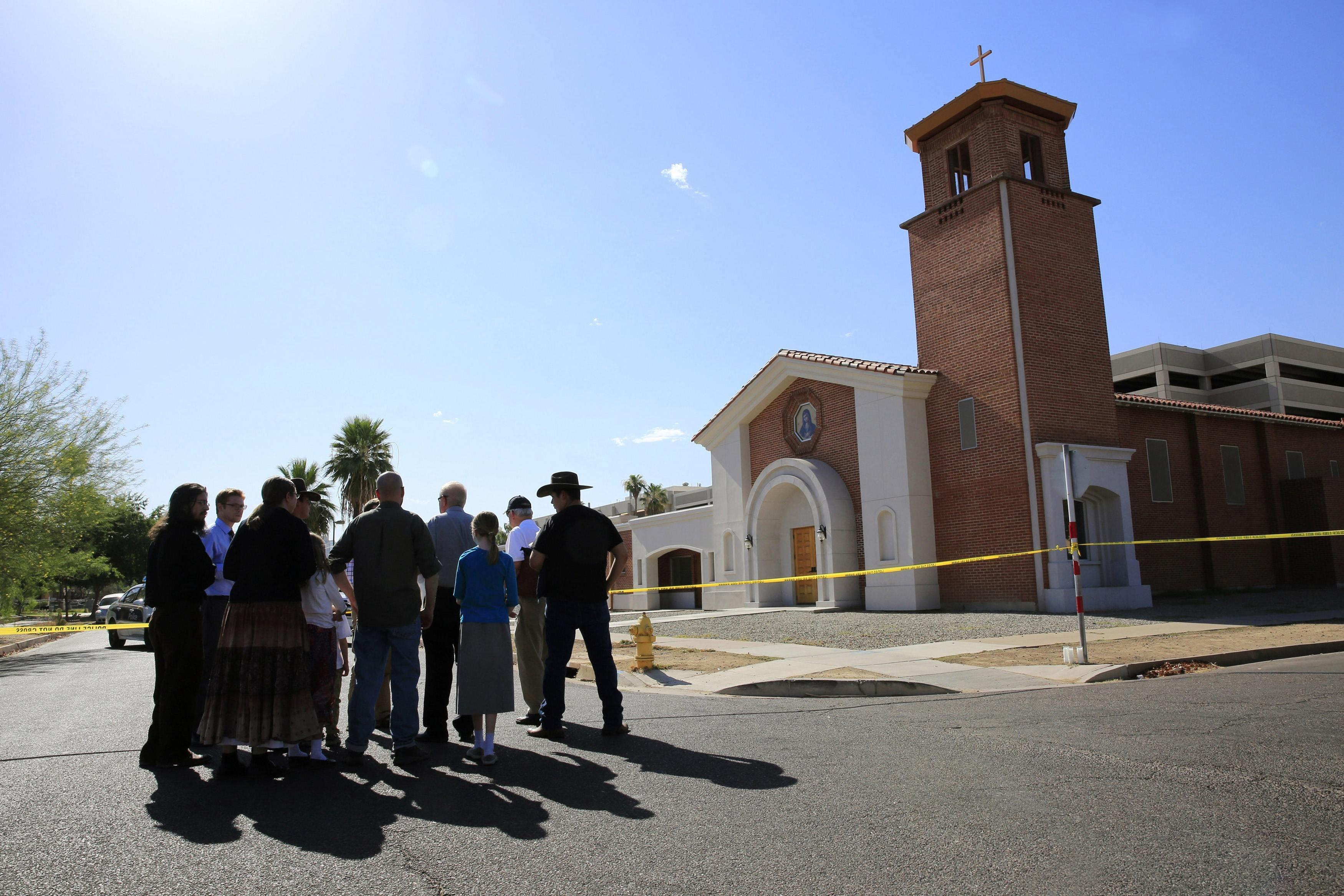 Image: Parishioners arrive to pray, outside the Mater Misericordiae Mission Catholic church in Phoenix