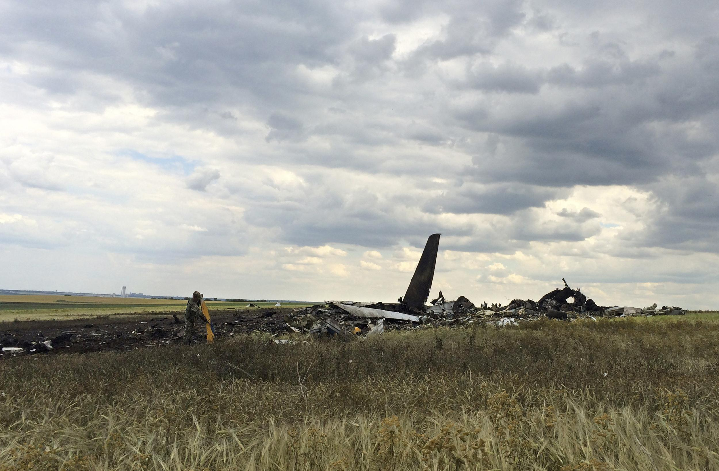 Image: Remnants of a downed Ukrainian army aircraft Il-76 lie on the ground at the airport near Luhansk, Ukraine, Saturday, June 14, 2014.