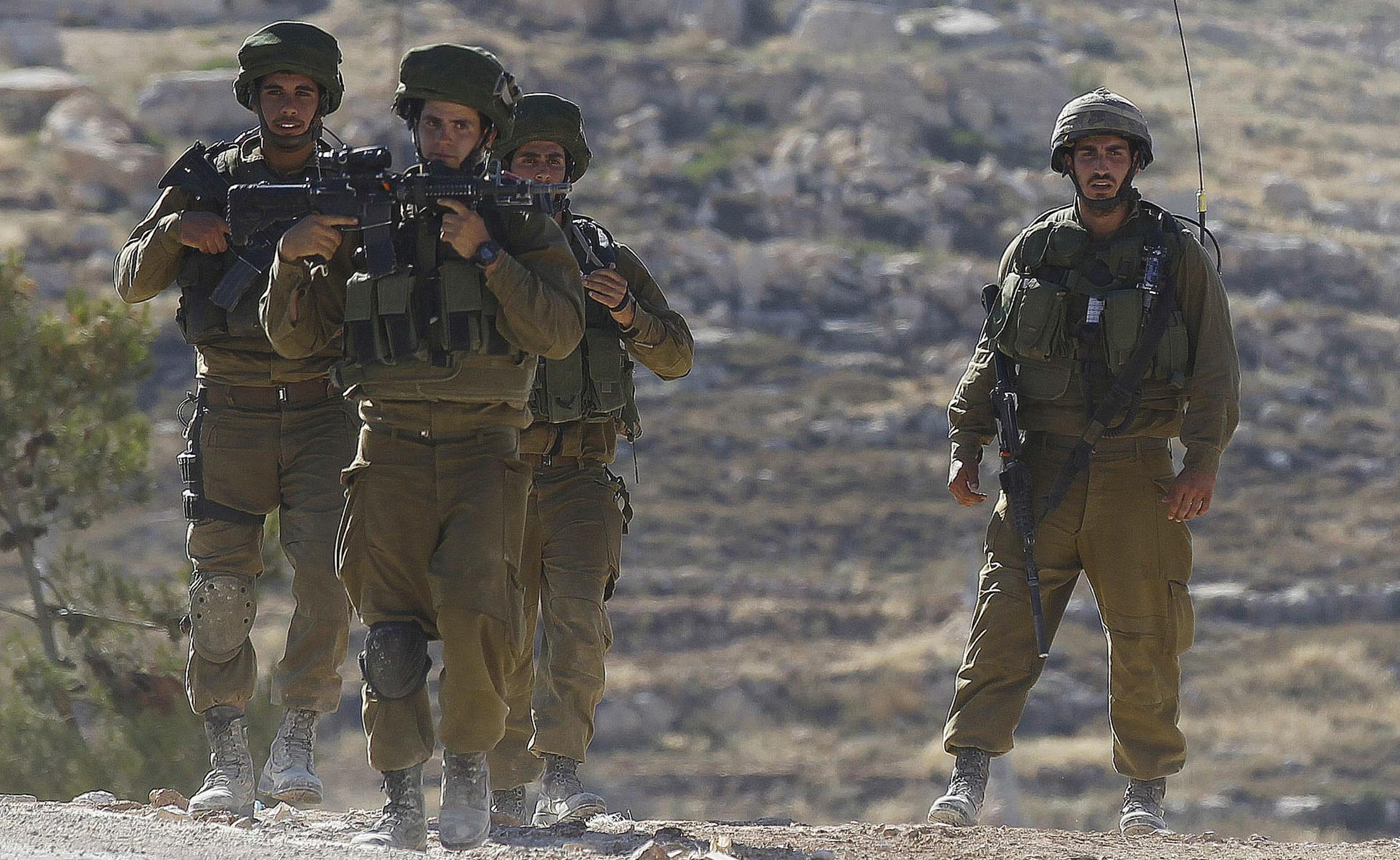 Image: Israeli soldiers patrol near Hebron