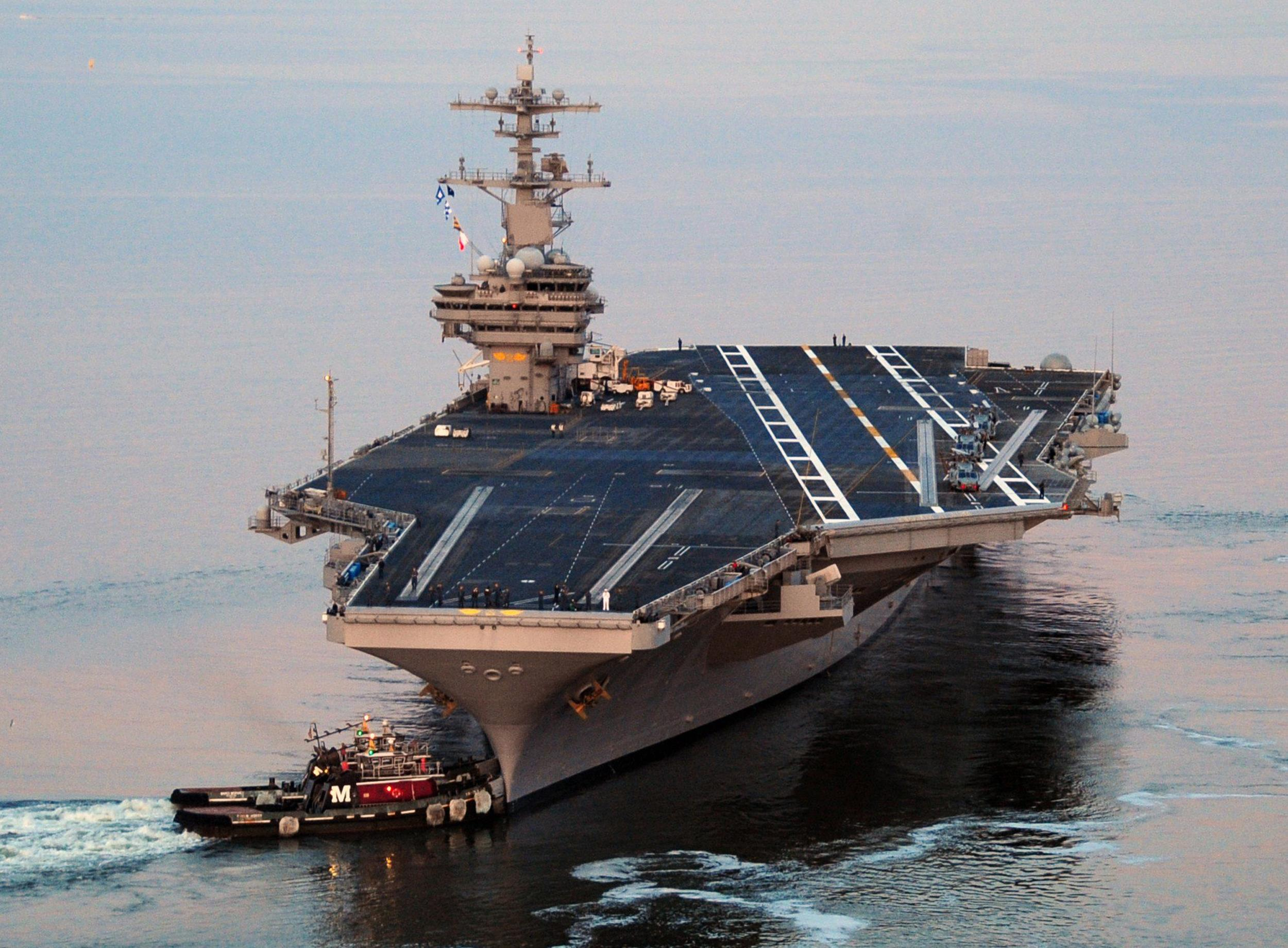 Image: The Nimitz-class aircraft carrier USS George H.W. Bush as it departs Naval Station Norfolk for its maiden deployment on May 11, 2011.