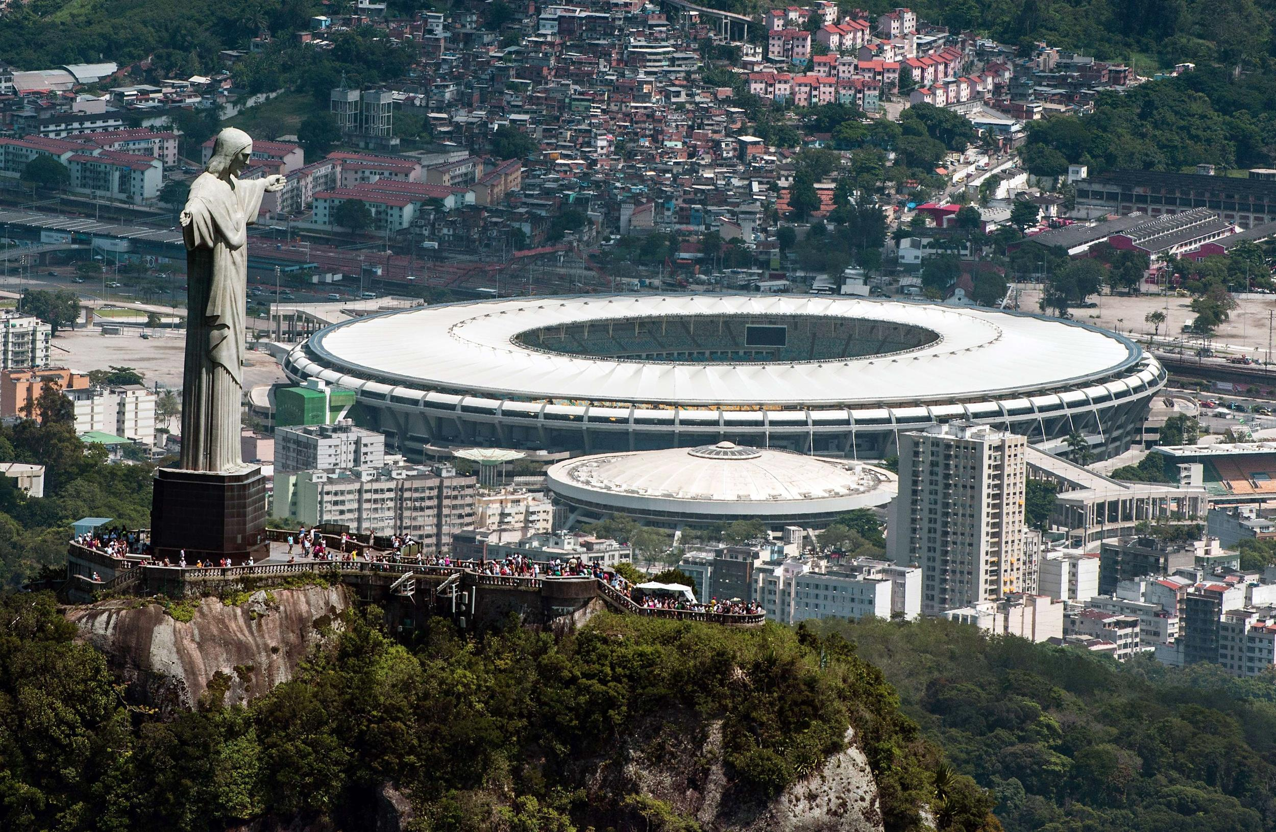 Image: Aerial view of the Christ the Redeemer statue atop Corcovado Hill and the Mario Filho (Maracana) stadium in Rio de Janeiro