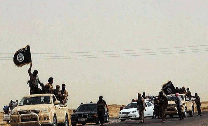 An image uploaded on June 14, 2014 on the jihadist website Welayat Salahuddin allegedly shows militants of the Islamic State of Iraq and the Levant (ISIL) driving on a street at unknown location in the Salaheddin province.