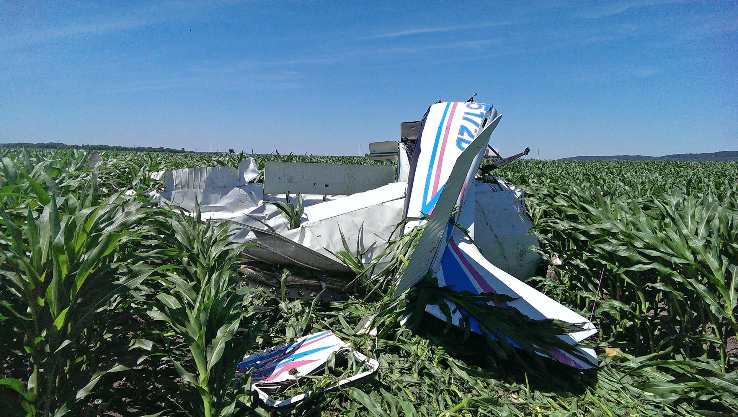 Image: The wreckage of the Cessna 182 skydiving plane that Shawn Kinmartin was flying rests in a cornfield Saturday