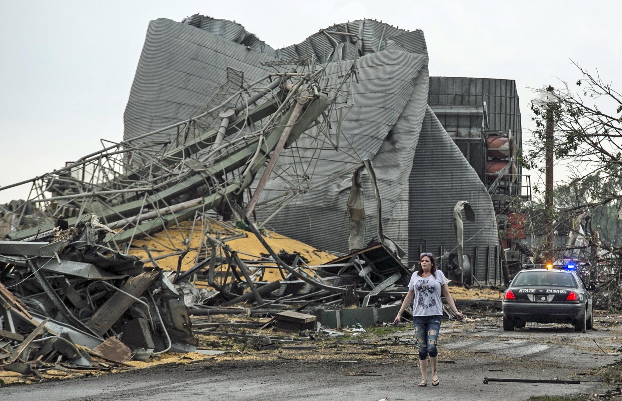 Image: A woman walks down Black Hills Trail road in Pilger, Neb.
