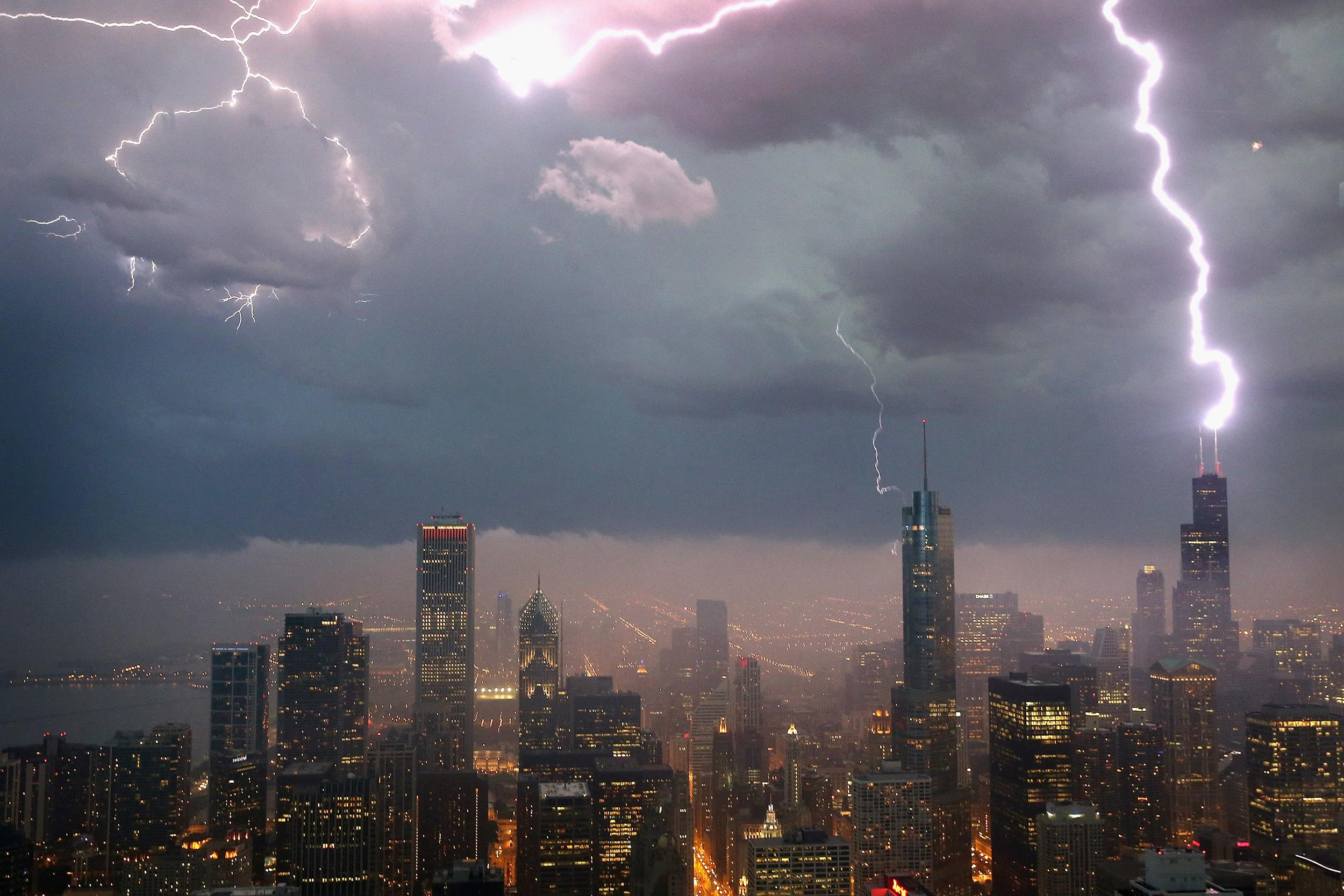 Image: Lightning strikes the Willis Tower (formerly Sears Tower) on June 12, 2013 in Chicago.