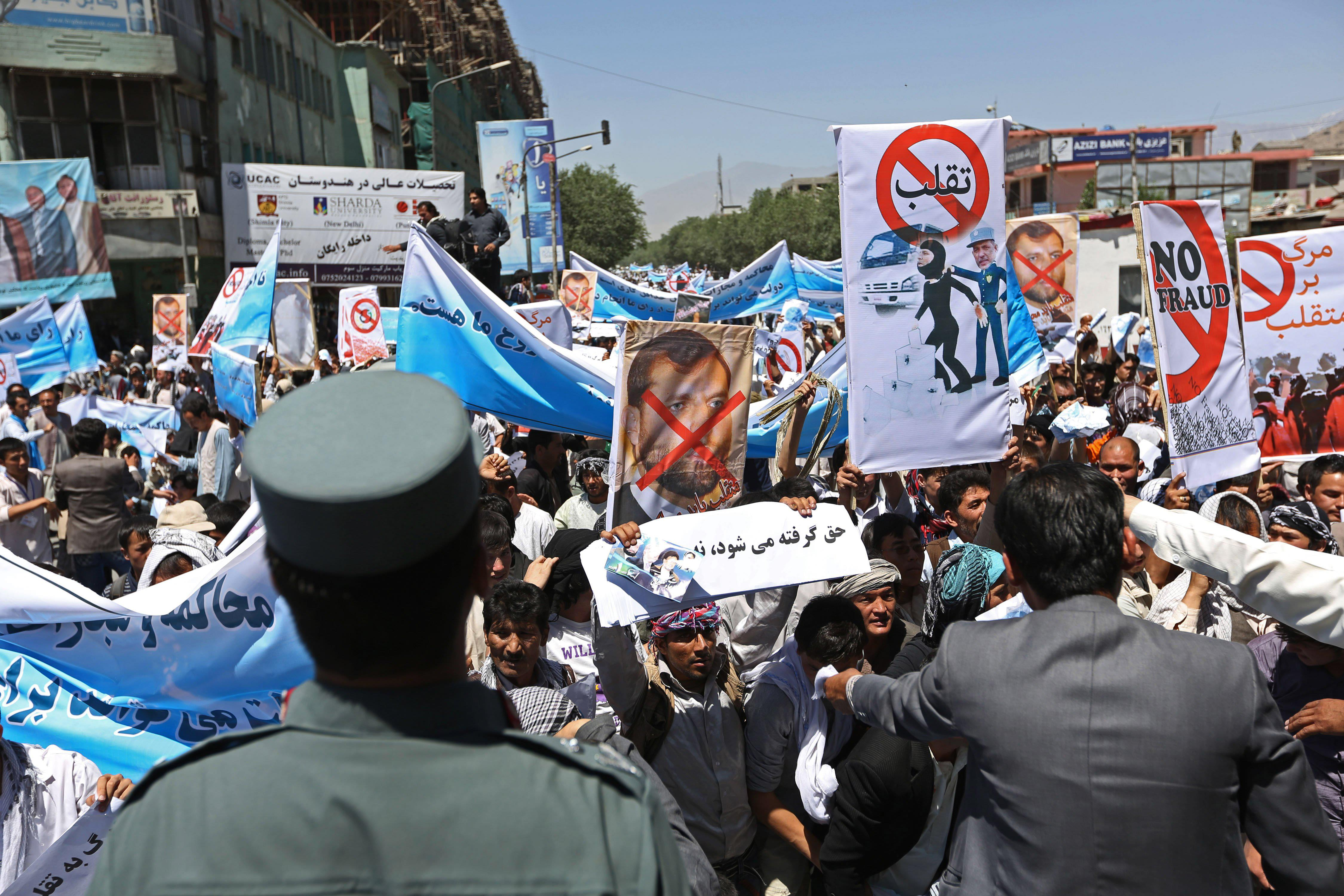 Image: Supporters of presidential candidate Abdullah Abdullah shouts slogans during a protest in Kabul, Afghanistan, on June 21.