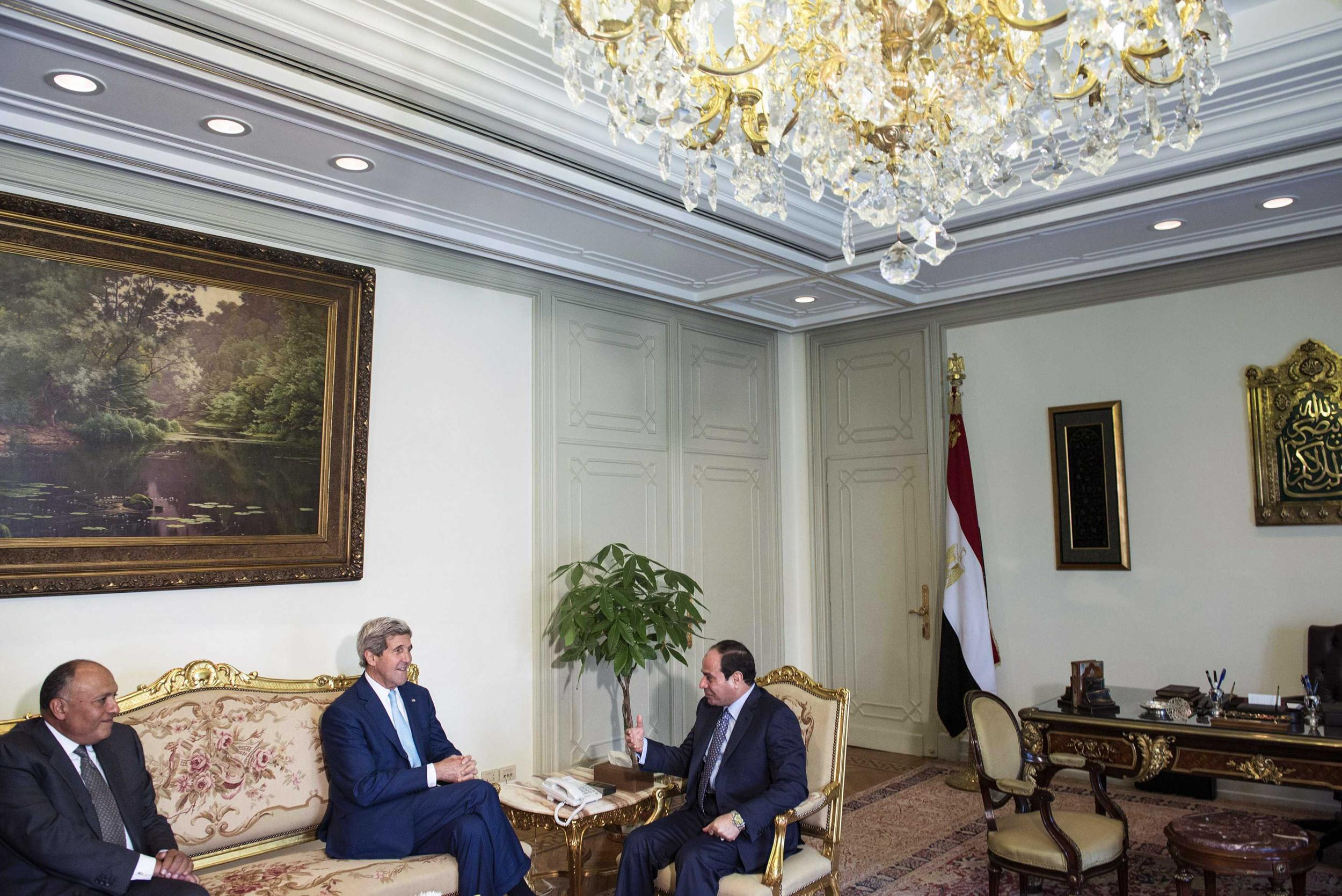 President al-Sisi and U.S. Secretary of State Kerry talk before a meeting at the Presidential Palace in Cairo